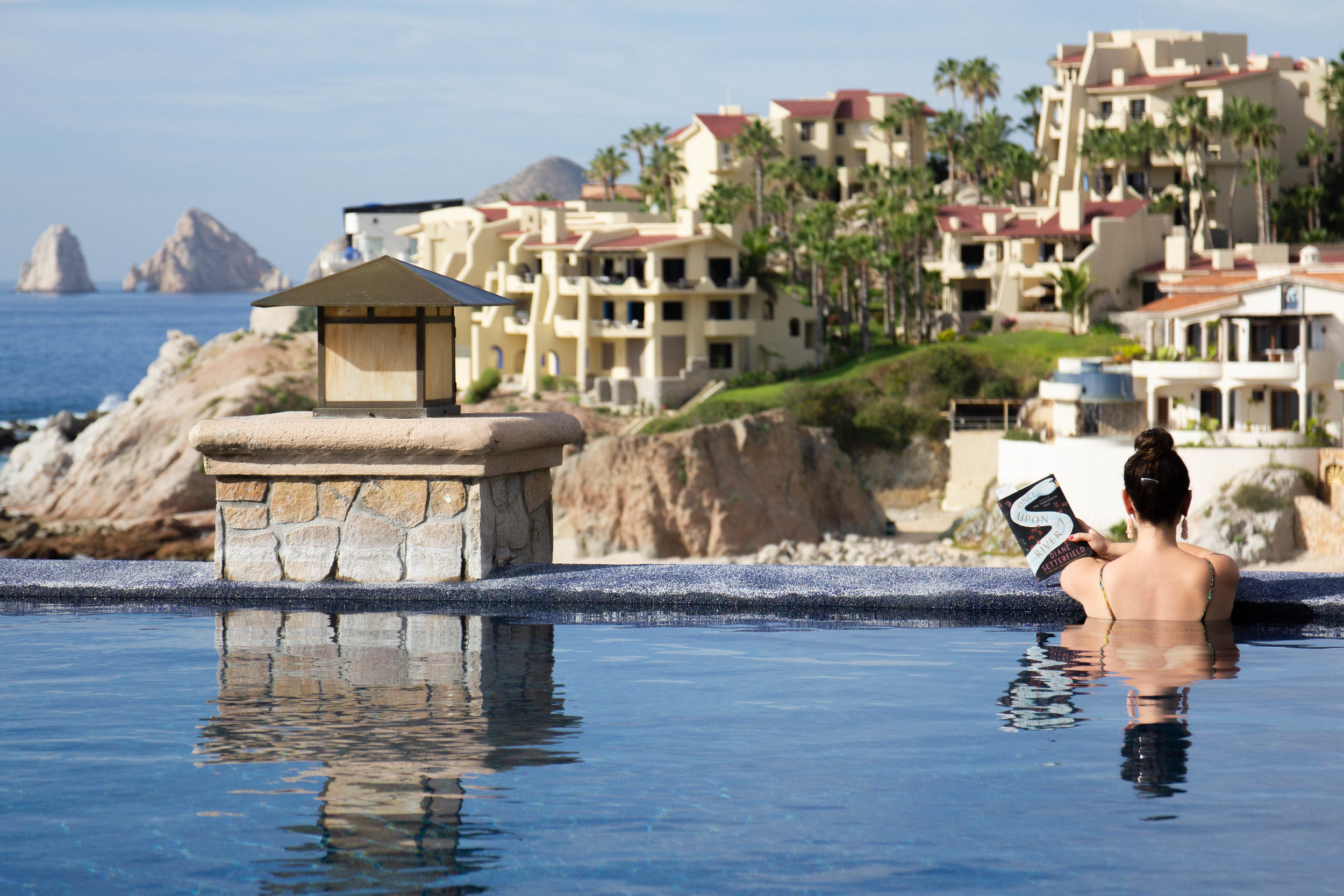 Reading Once Upon a River by Diane Setterfield at Sirena del Mar in Cabo, Mexico