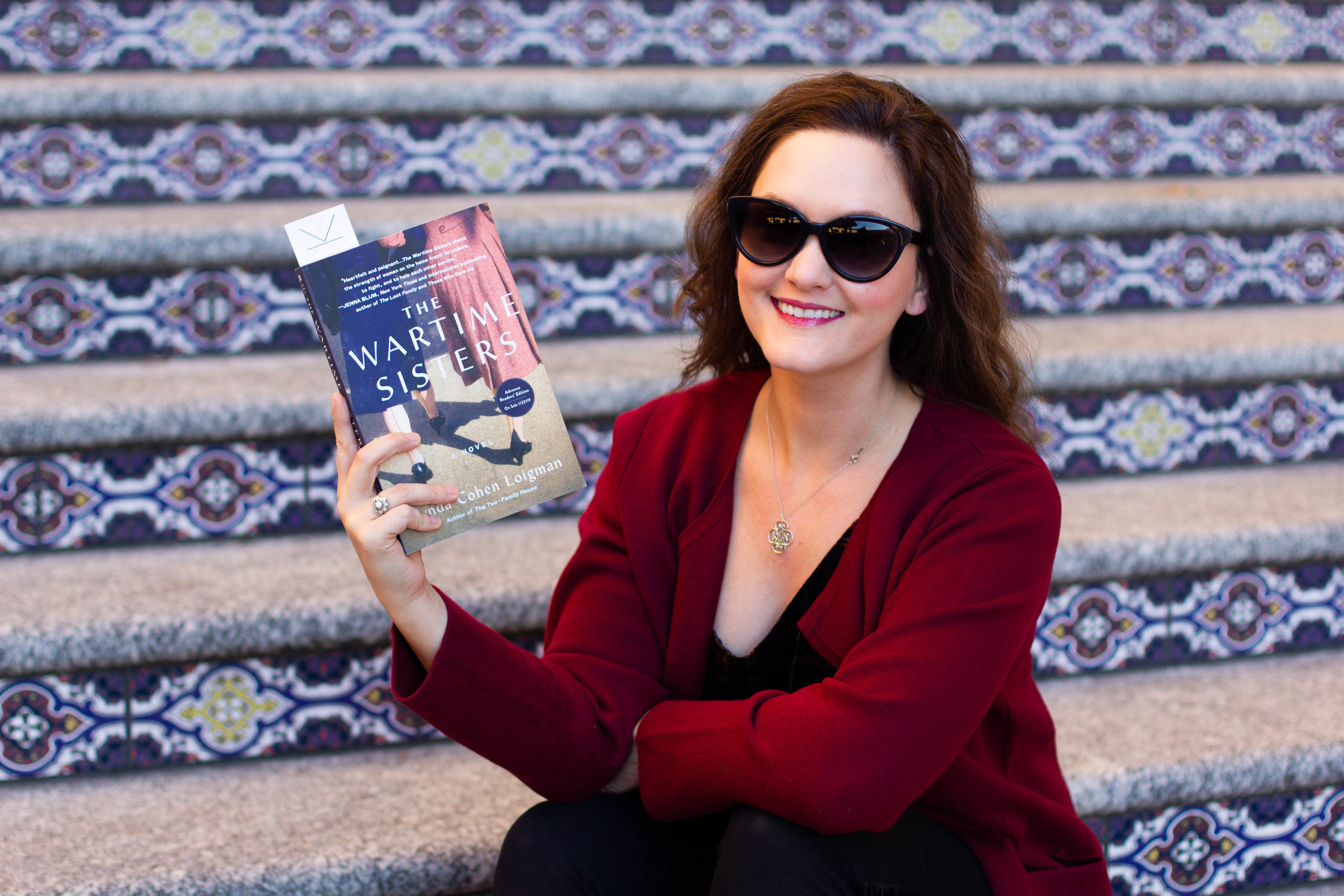 Reading The Wartime Sisters by Lynda Cohen Loigman at the Country Club Plaza in Kansas City, MO