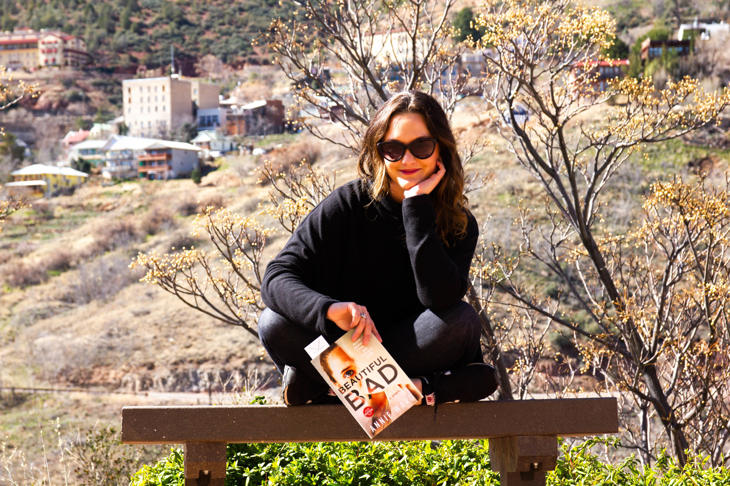 Reading Beautiful Bad by Annie Ward in Jerome, AZ