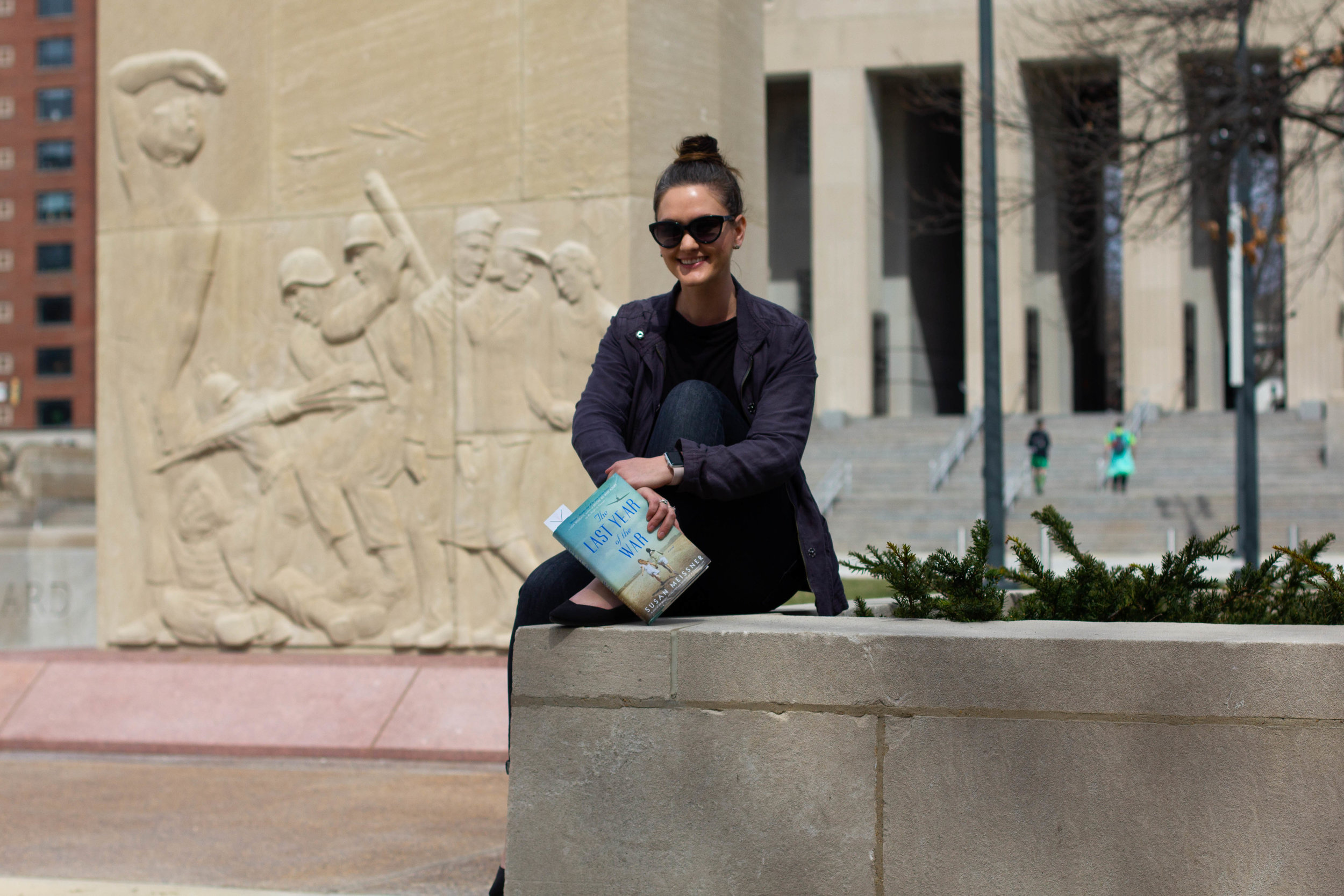 Reading The Last Year of the War by Susan Meissner at the Court of Honor, a monument in honor of WWII victims in St. Louis, MO