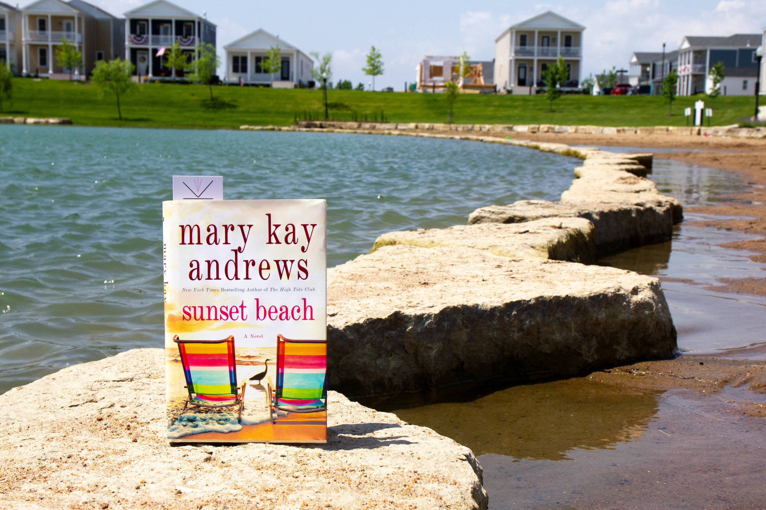 Reading Sunset Beach by Mary Kay Andrews at the beach at New Town in St. Charles, MO