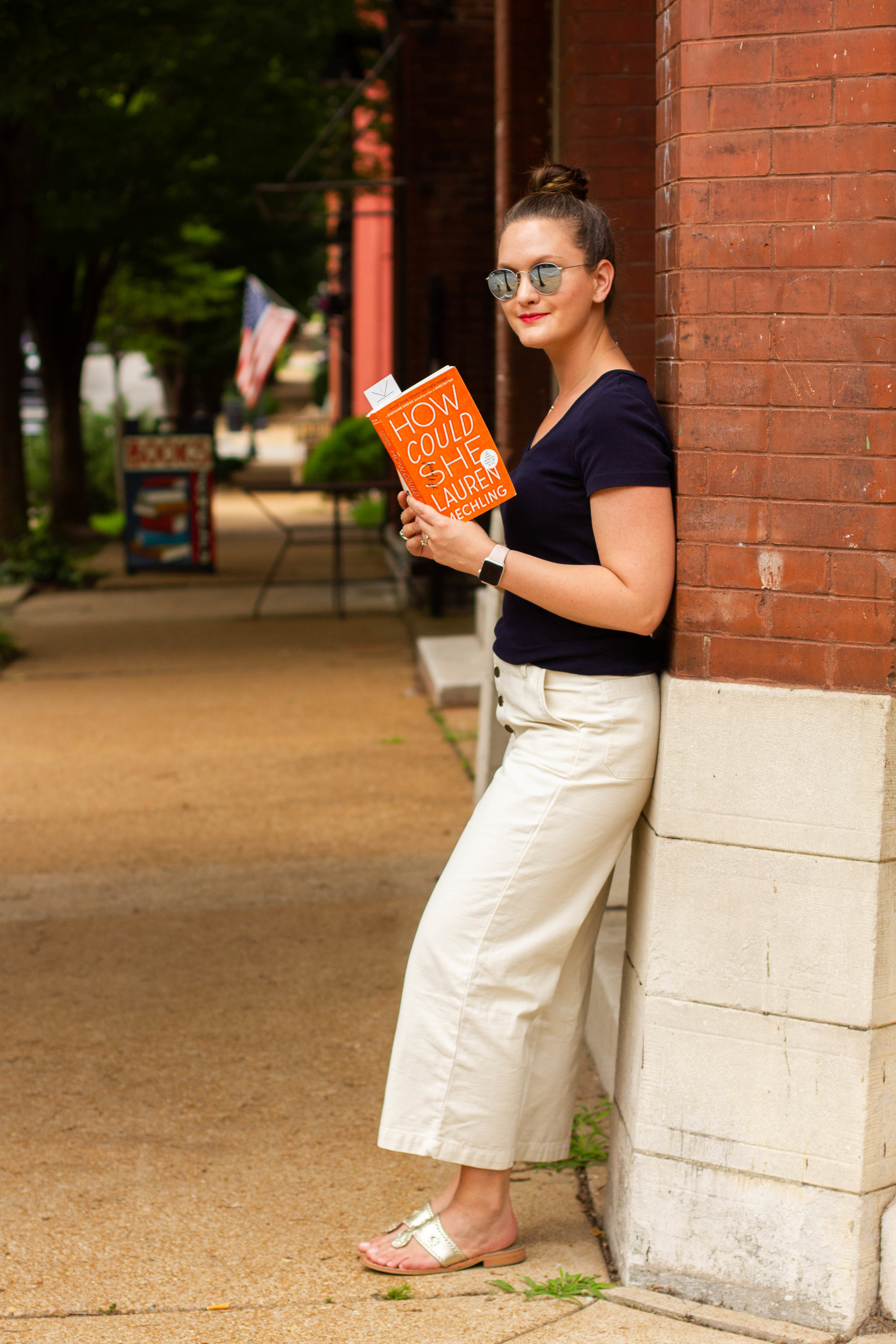 Reading How Could She by Lauren Mechling on Cherokee Street in St. Louis, MO