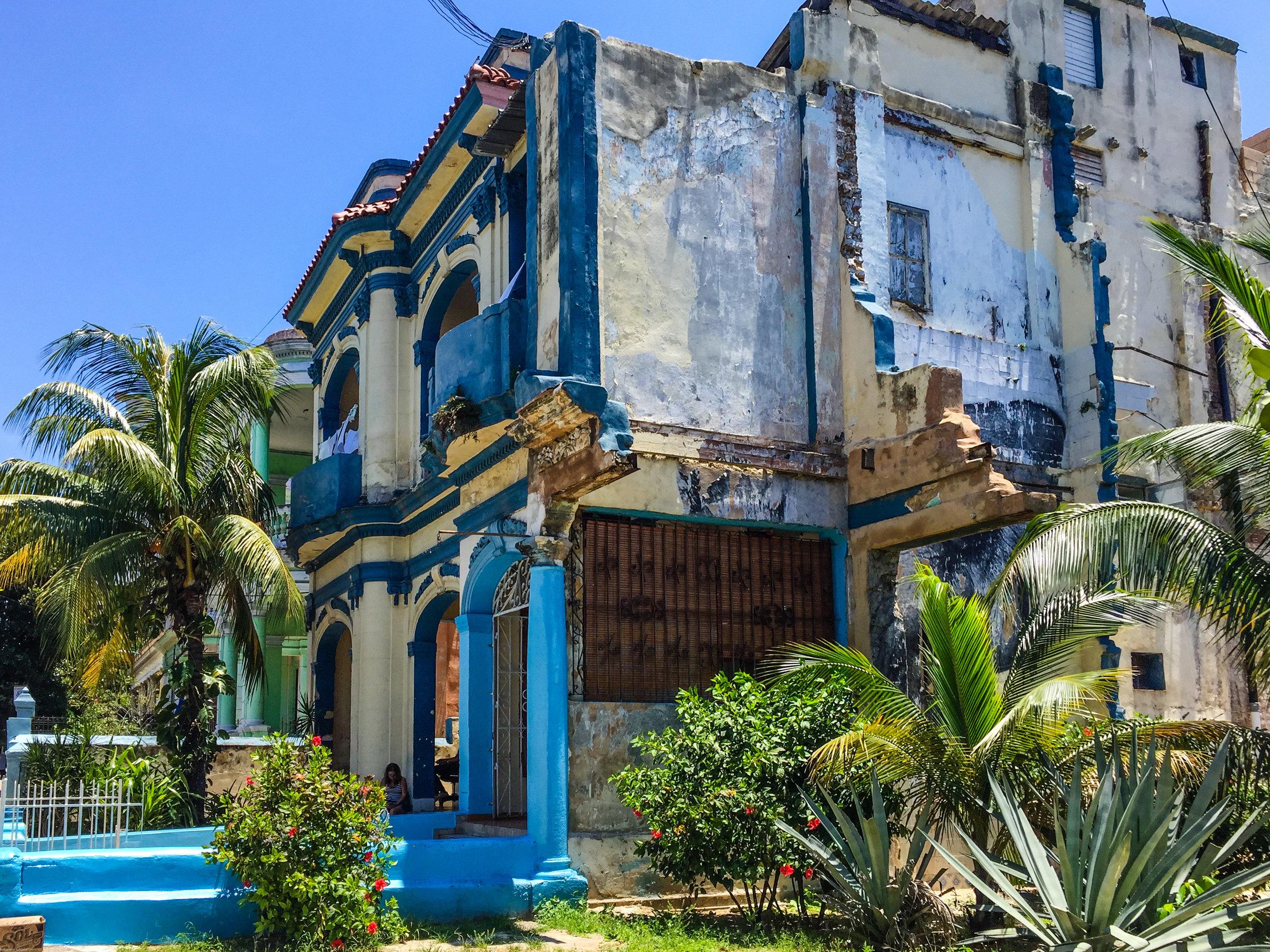A crumbling blue house in Havana.