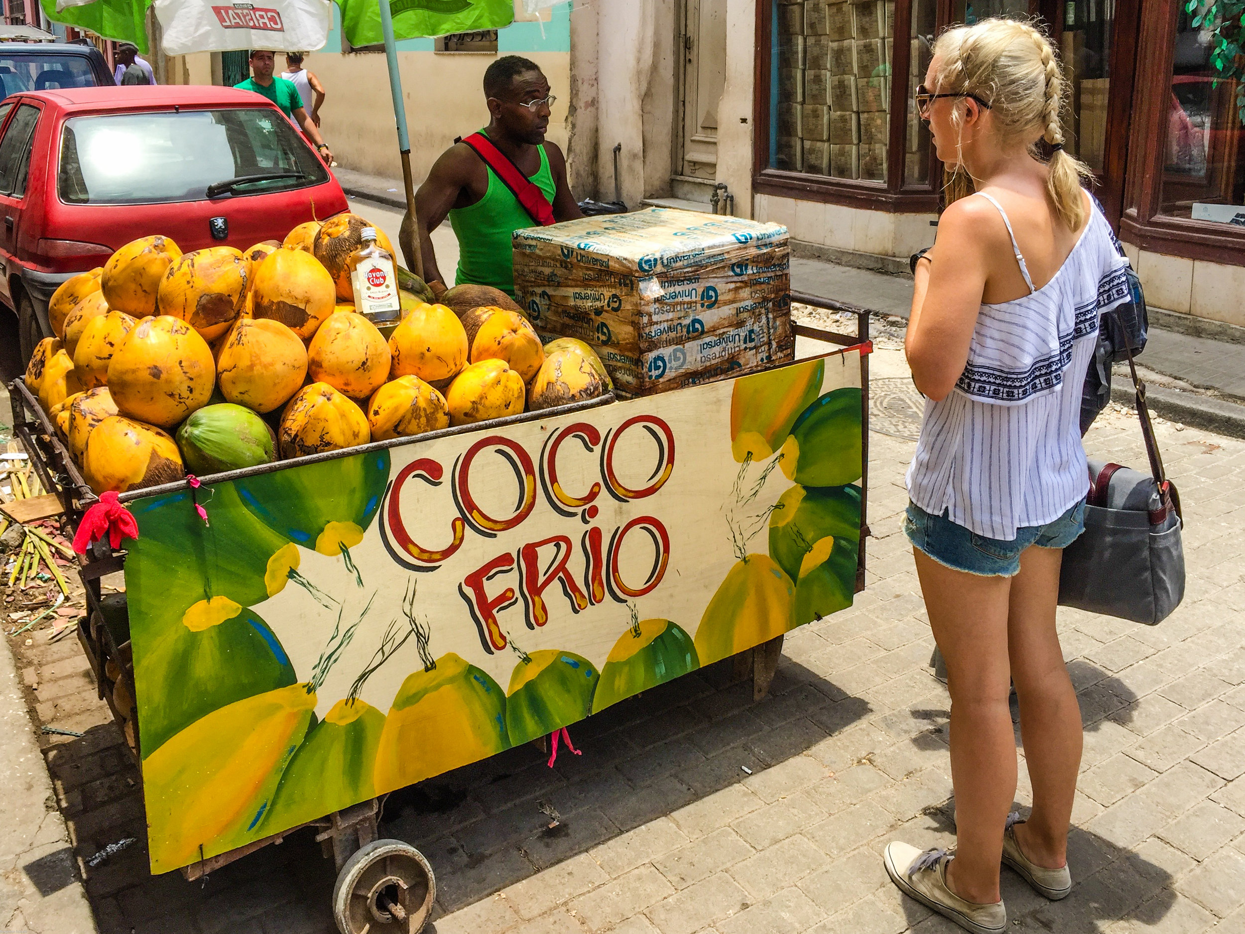 The greens and yellows of a delicious coconut stall
