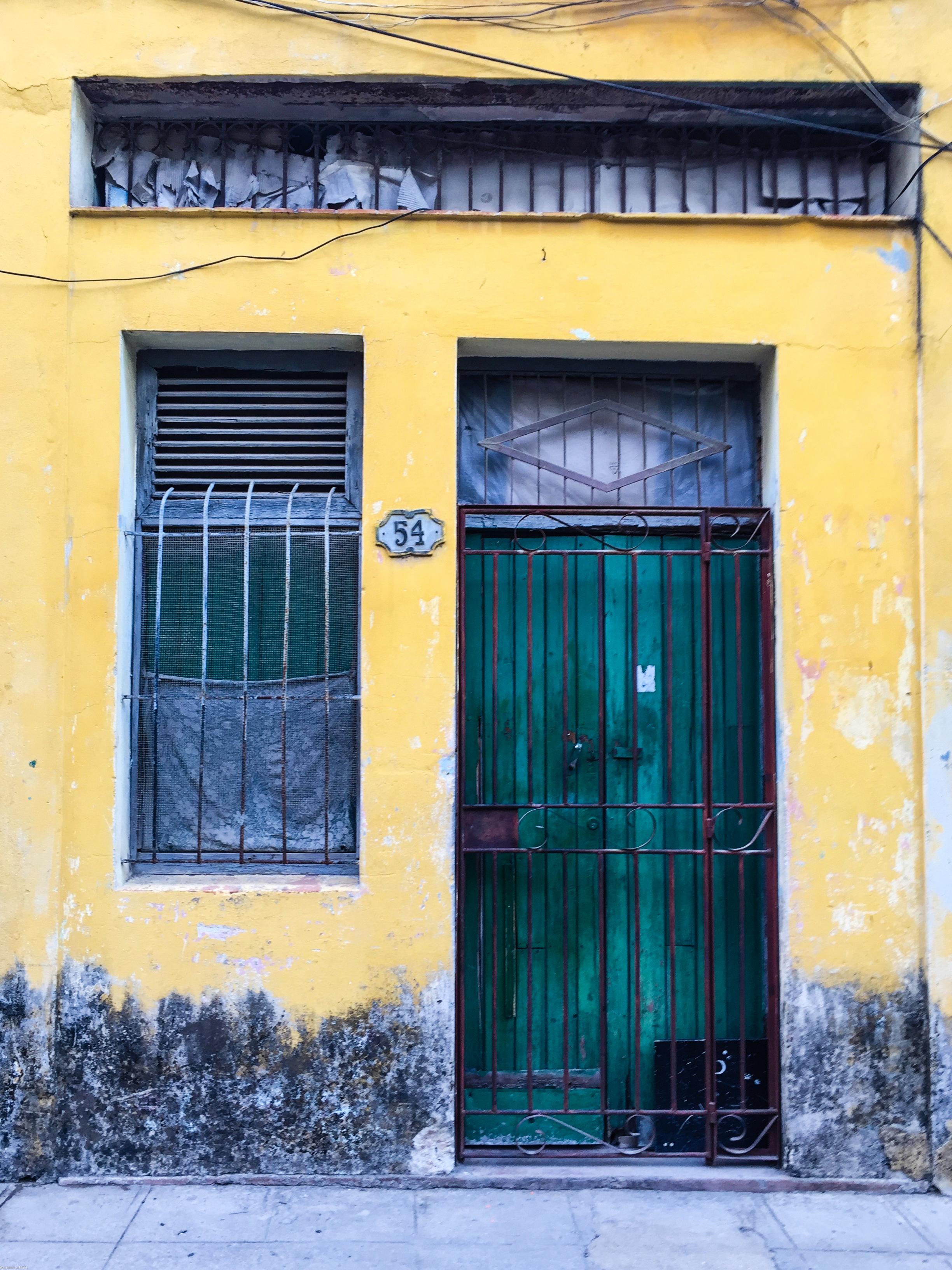Metallic green door in Havana