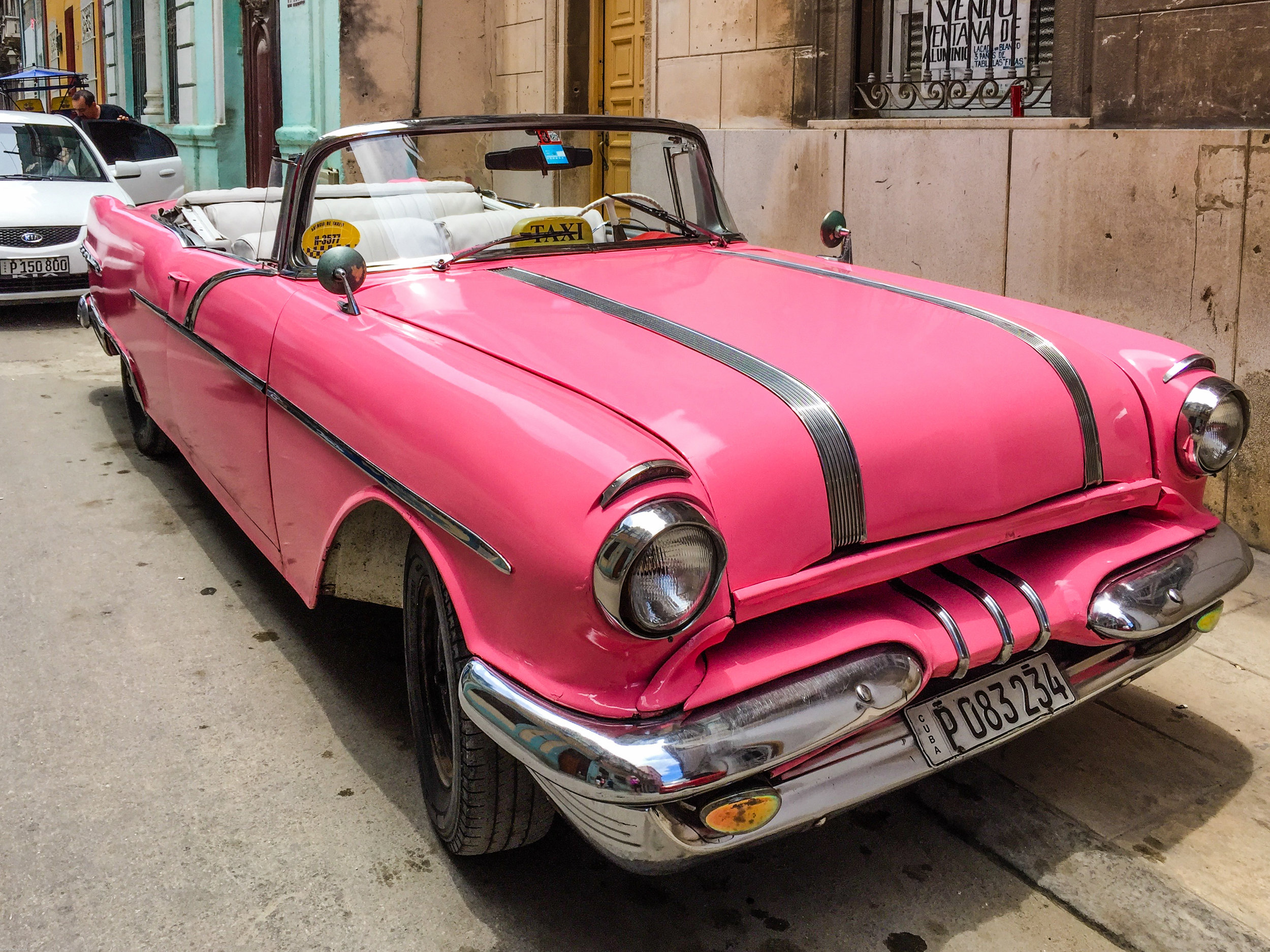 One of many classic pink cars in Havana