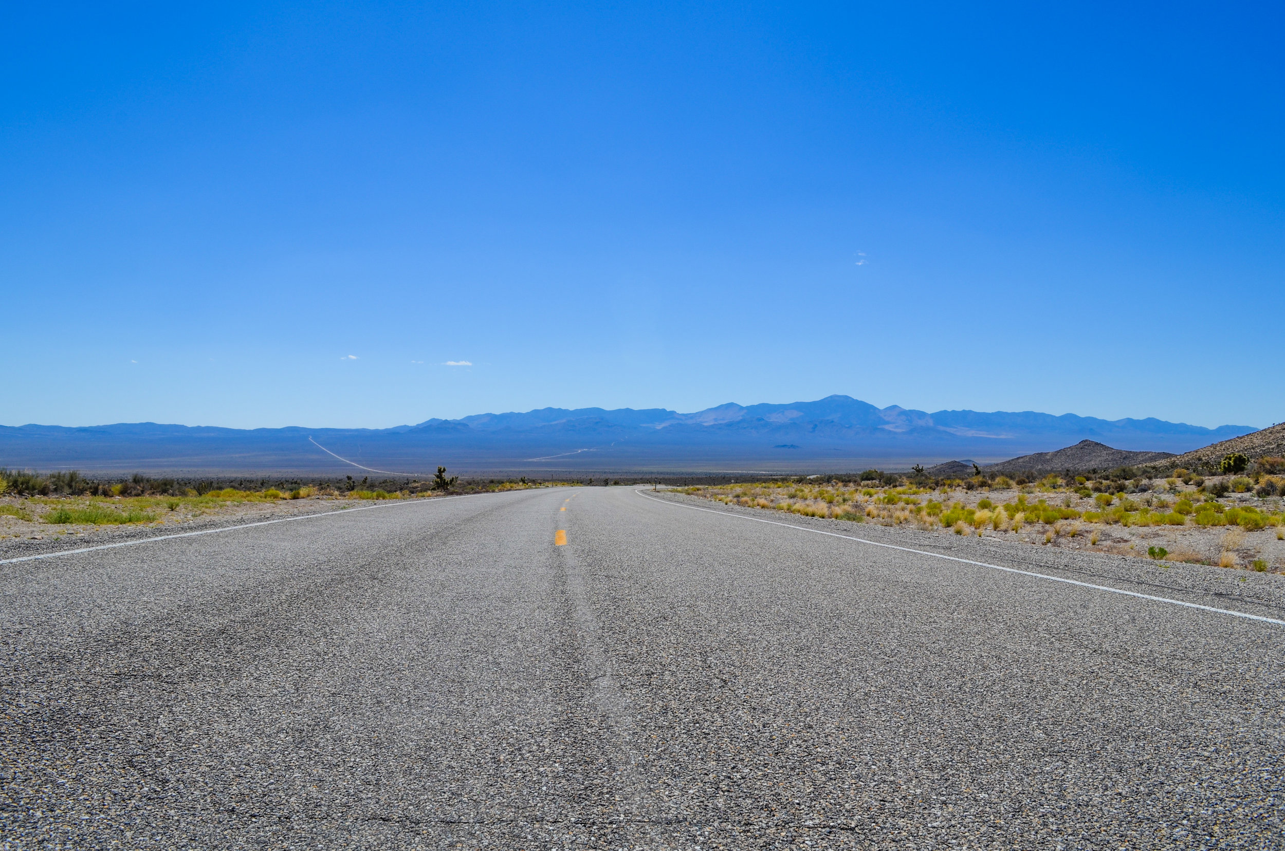 Mountains embrace a beautifully endless road