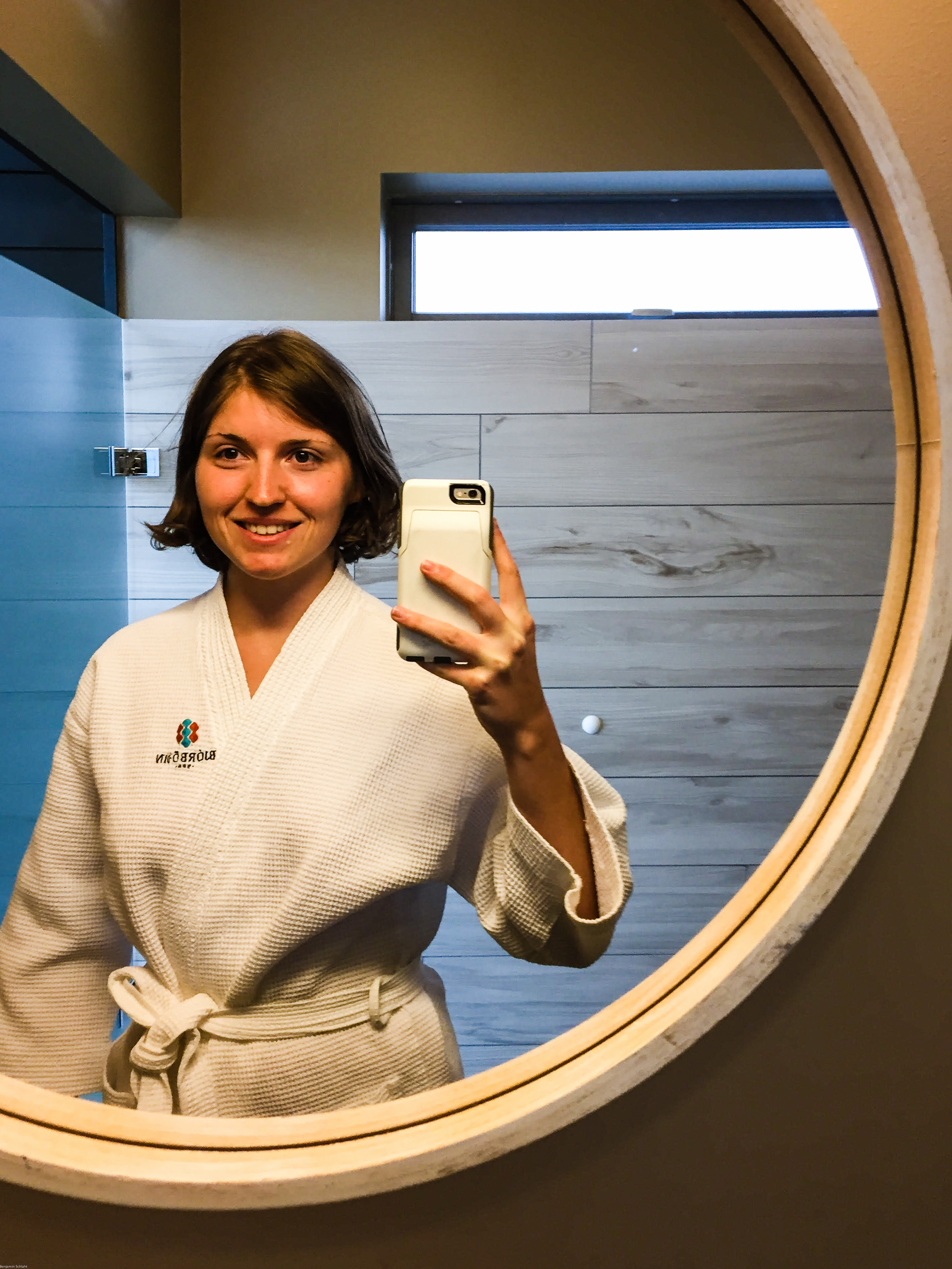 Mrs. Nerd in her robe, loving the huge mirror in the dressing room