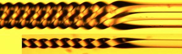 Square capillary tubing with outer dimensions of 120 x 120 µm twisted axially. The inset shows an image of the same tube taken with index matching fluid to reveal the 40 x 40 µm twisted capillary.