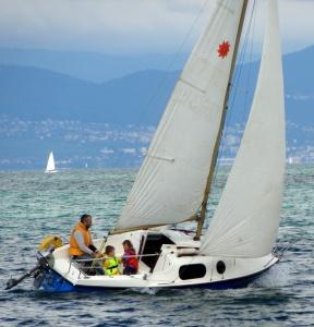 Leisure 17 'Tadjoura' under full sail in Switzerland