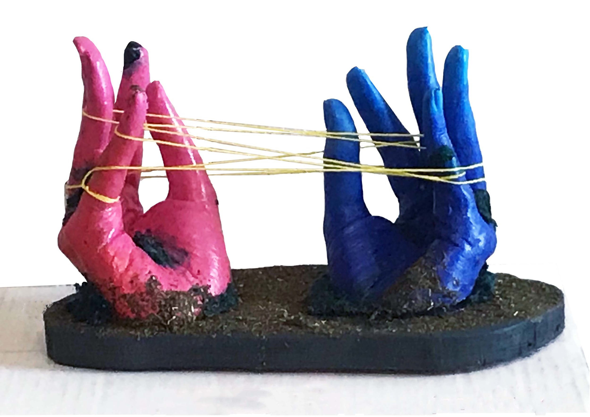 Final   Student made a mixed media sculpture of hands play cats in the cradle. She was exploring the dichotomy between interconnectivity and fragility that exists in the universe.  Plaster, String, and Moss
