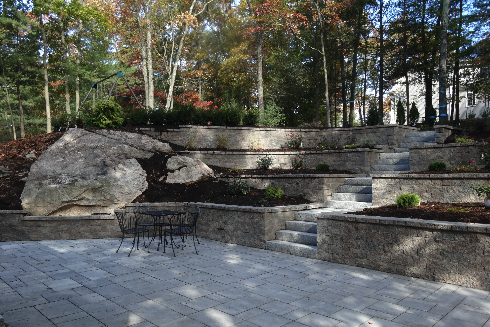 Professional patio installation with retaining wall in Chestnut Hill, MA