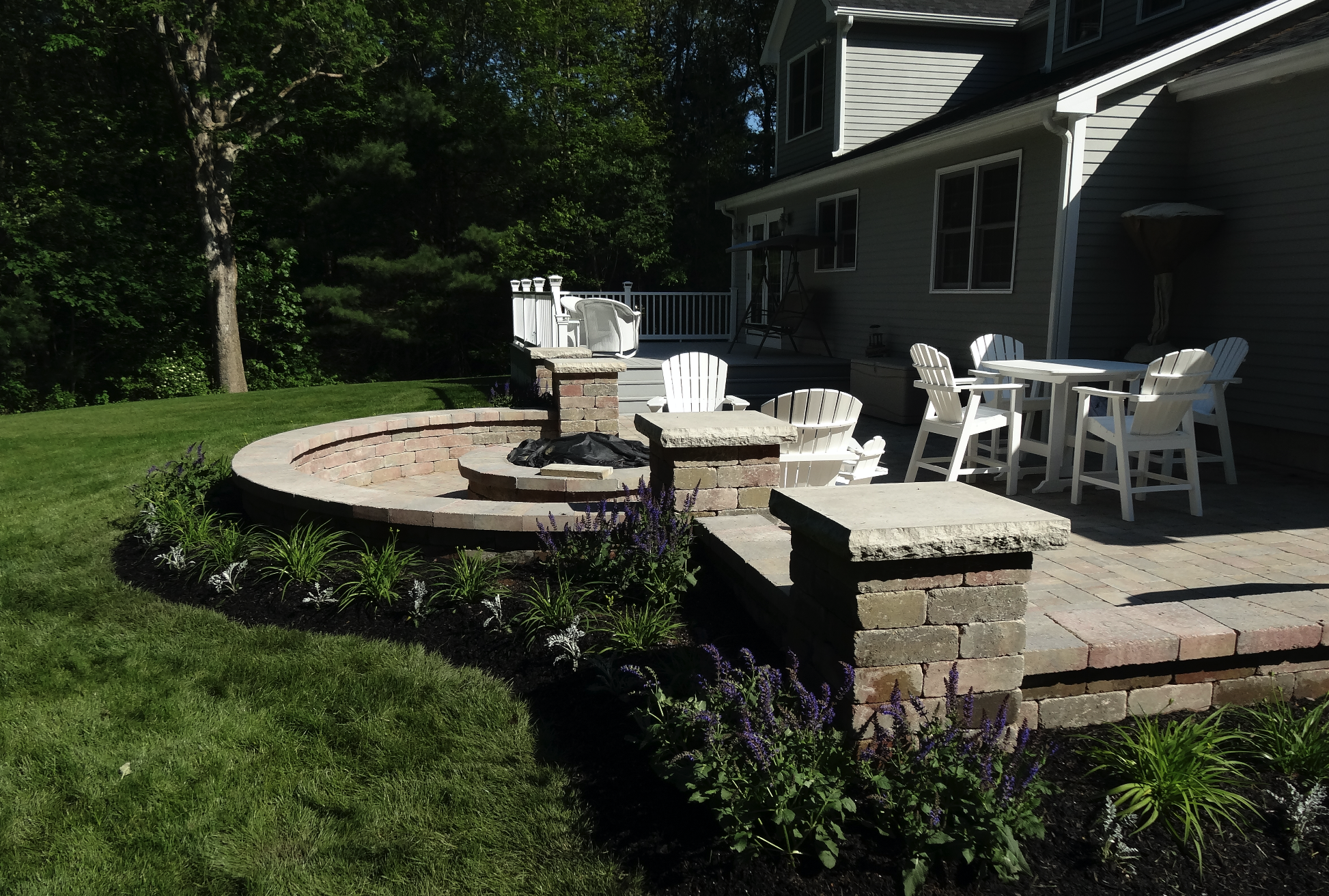 Front yard landscaping with qulity patio installation in Chestnut Hill, MA