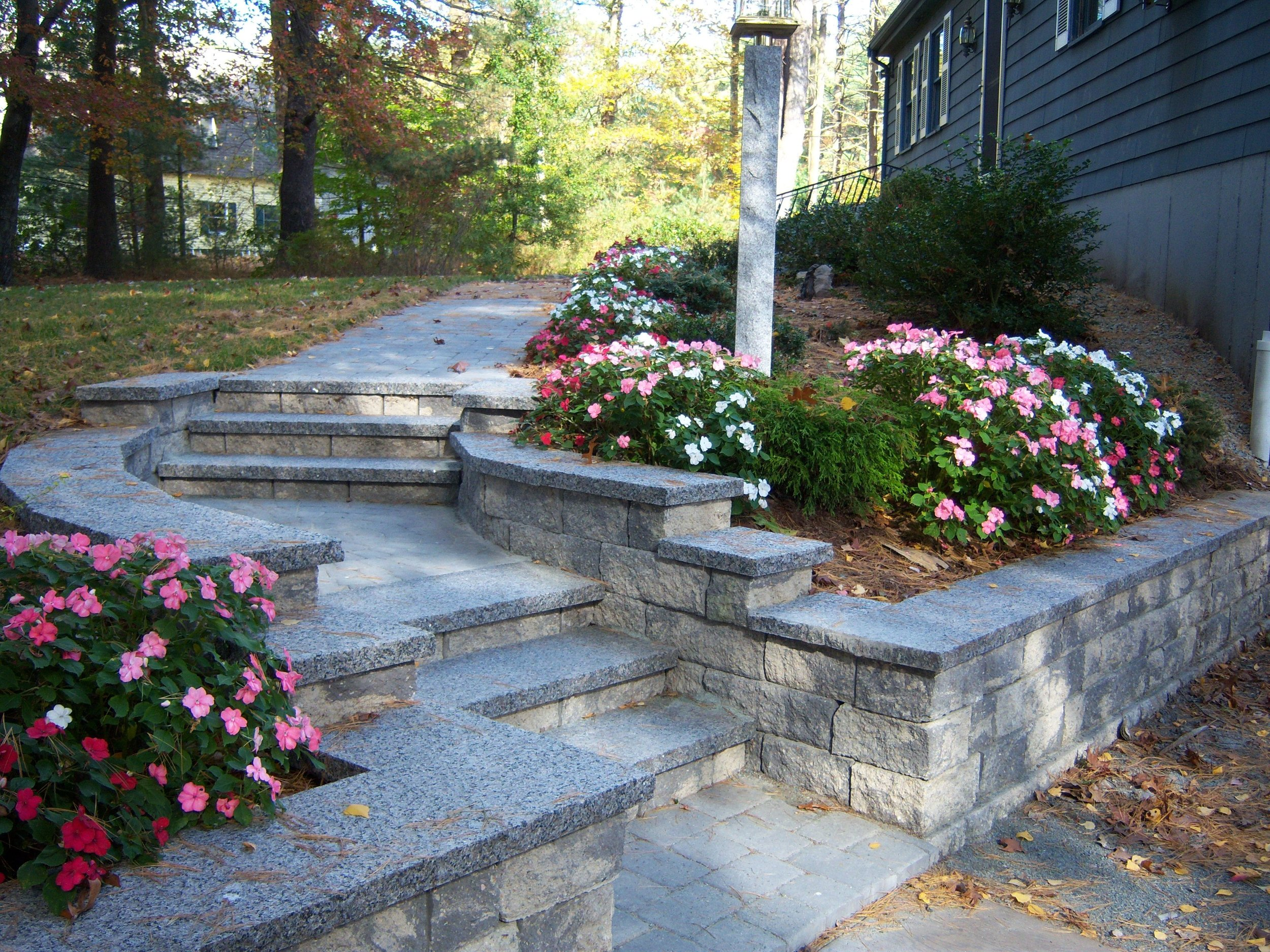Landscape design with retaining wall in Weston, MA.