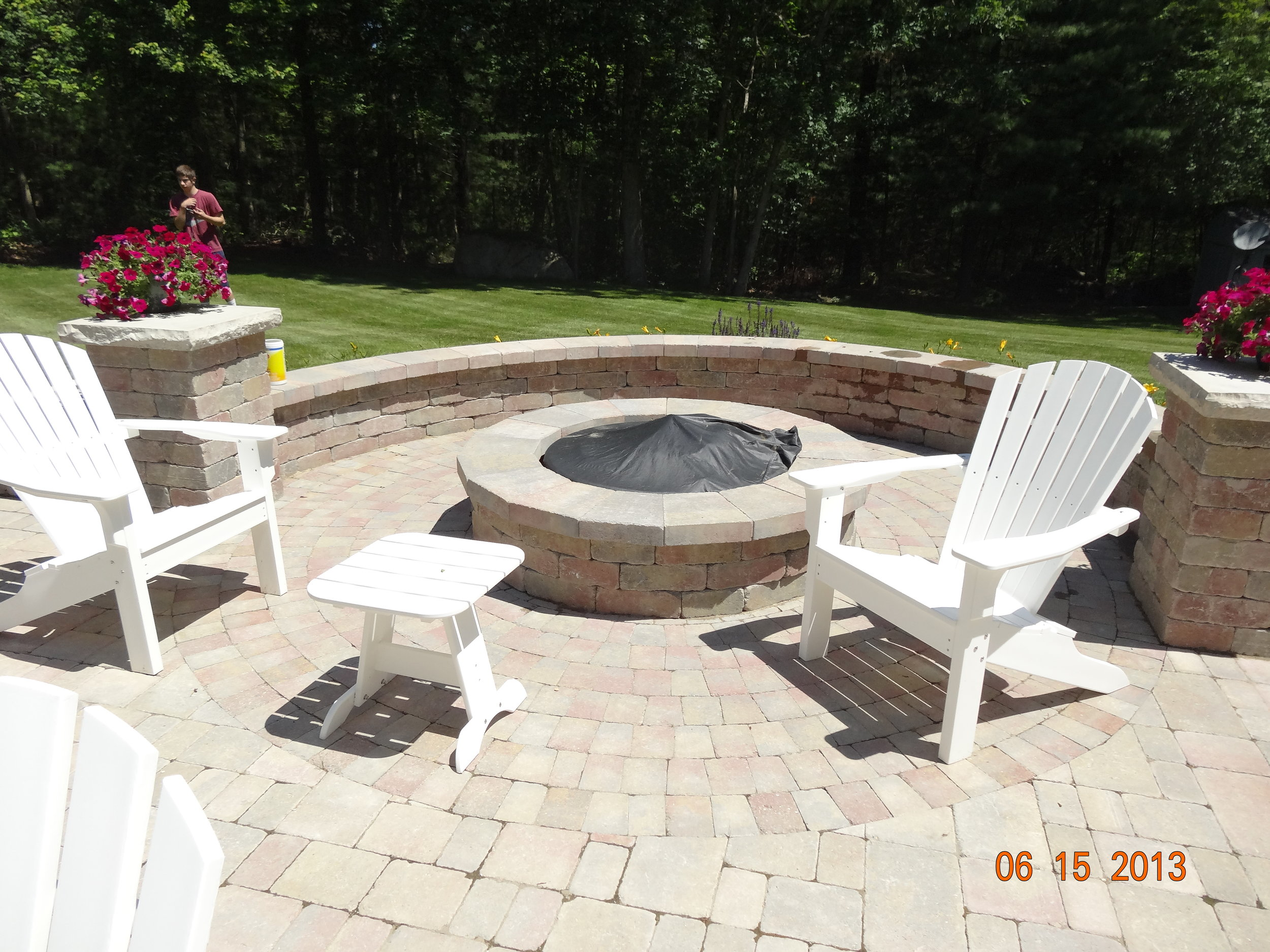 Professional outdoor fireplace landscape design in Norfolk Massachusetts
