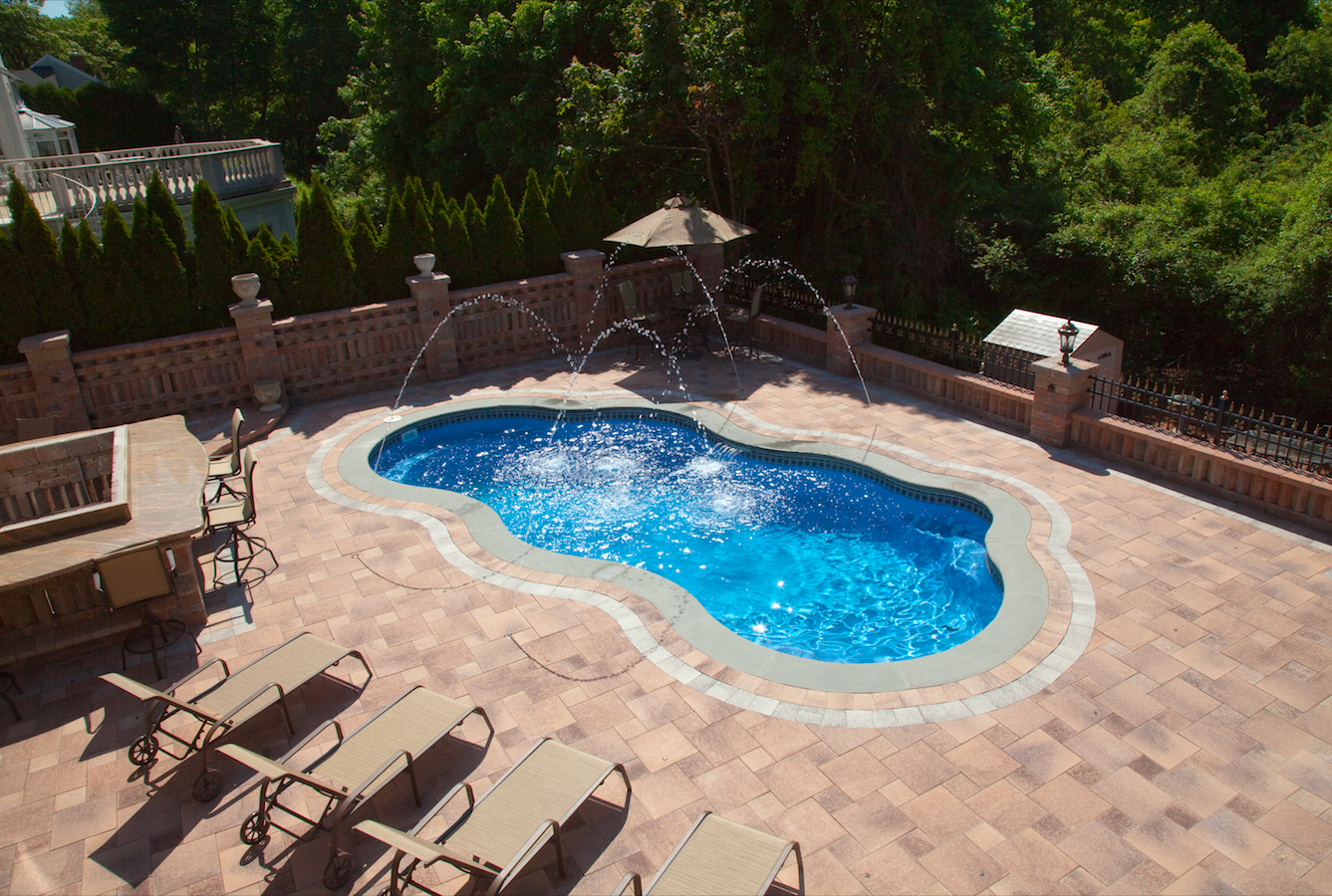 Deciding on Concrete Pavers for Your Pool Patio Installation Project in Millis, MA