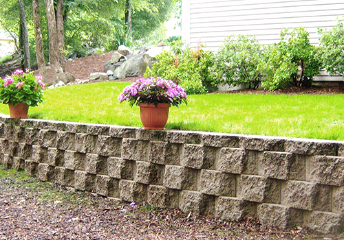 Stunning landscape design with retaining wall in Chestnut Hill MA
