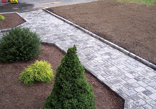 Landscape design with walkway in Newton MA