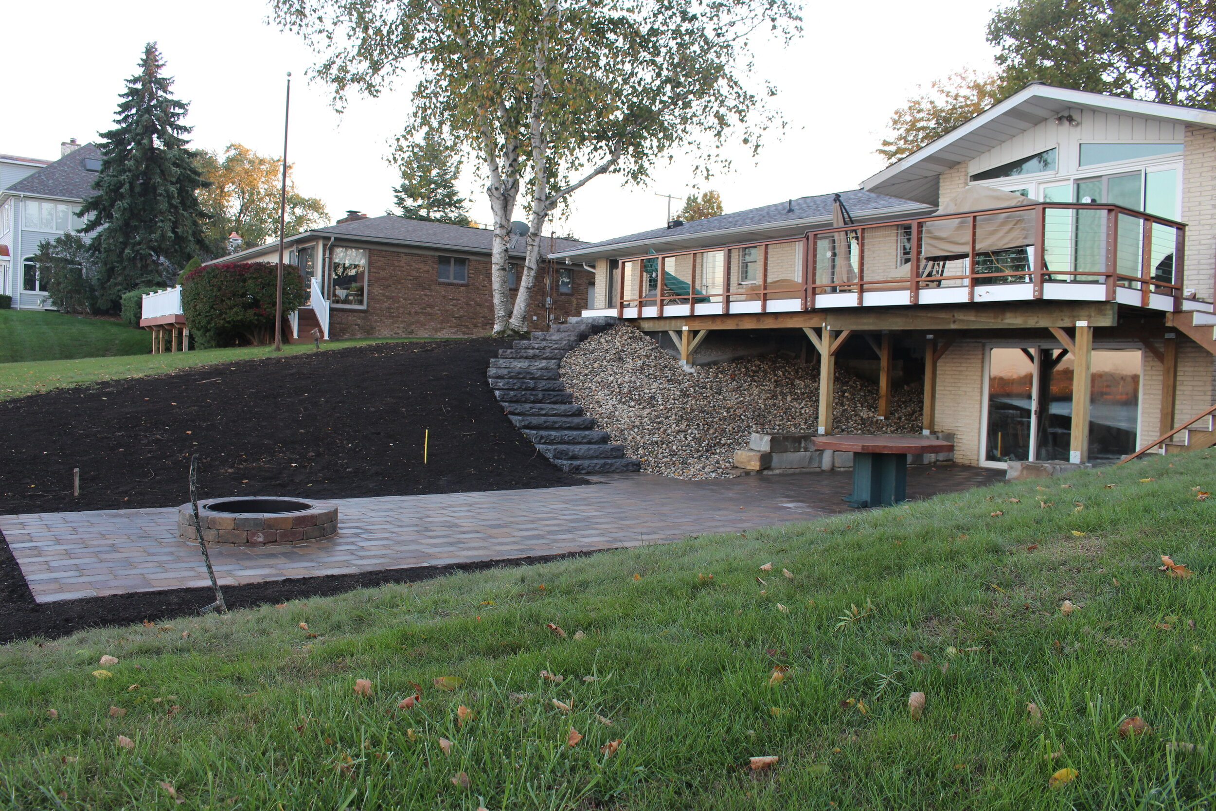 Include an Outdoor Fireplace in Your Landscaping This Fall in Weston, MA