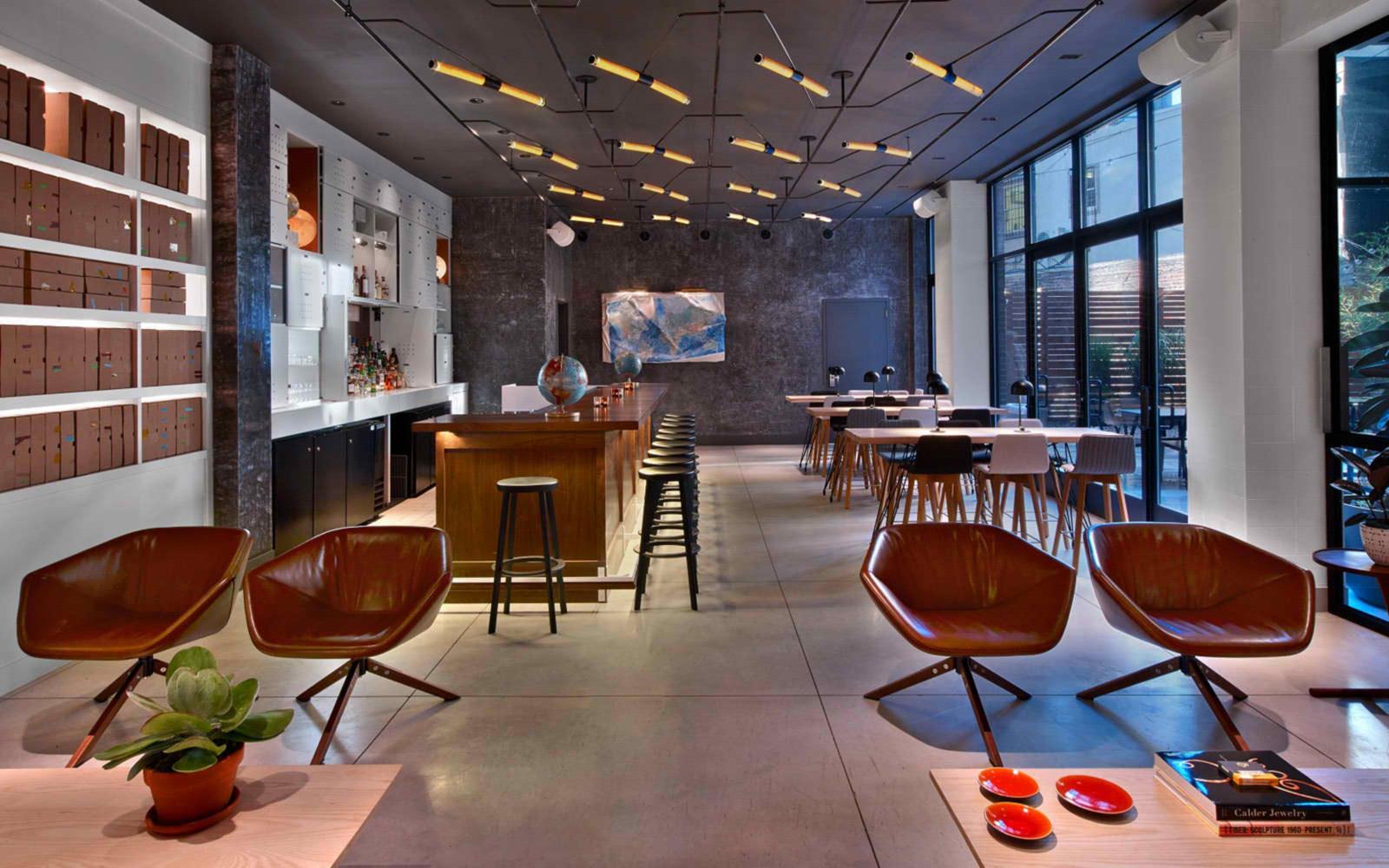 9-arlo-hudson-square-liquor-bar-seating-daytime-1600x1000-2.jpg