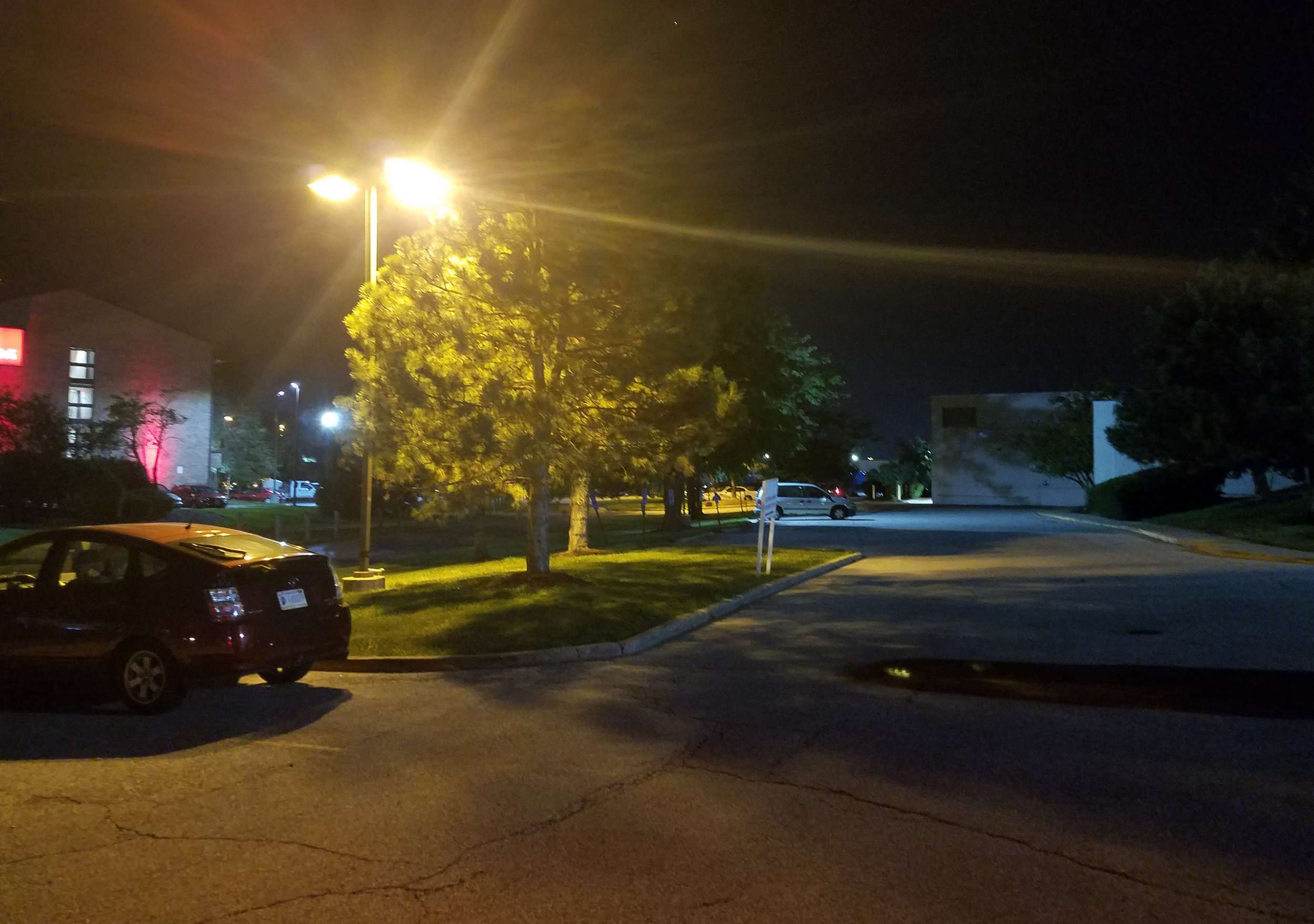 Before  installation of LED pole lights at an Indianapolis hotel parking lot.