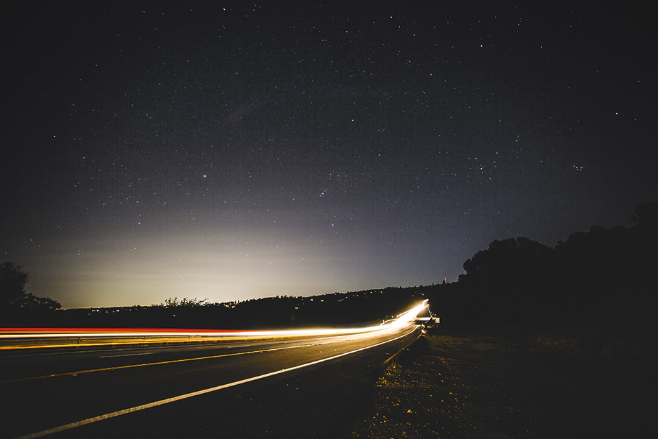 Figure 3:    Illuminated road and visible skyglow in a suburban area in the US (Photo Credits: Mark Tuzman/Unsplash)