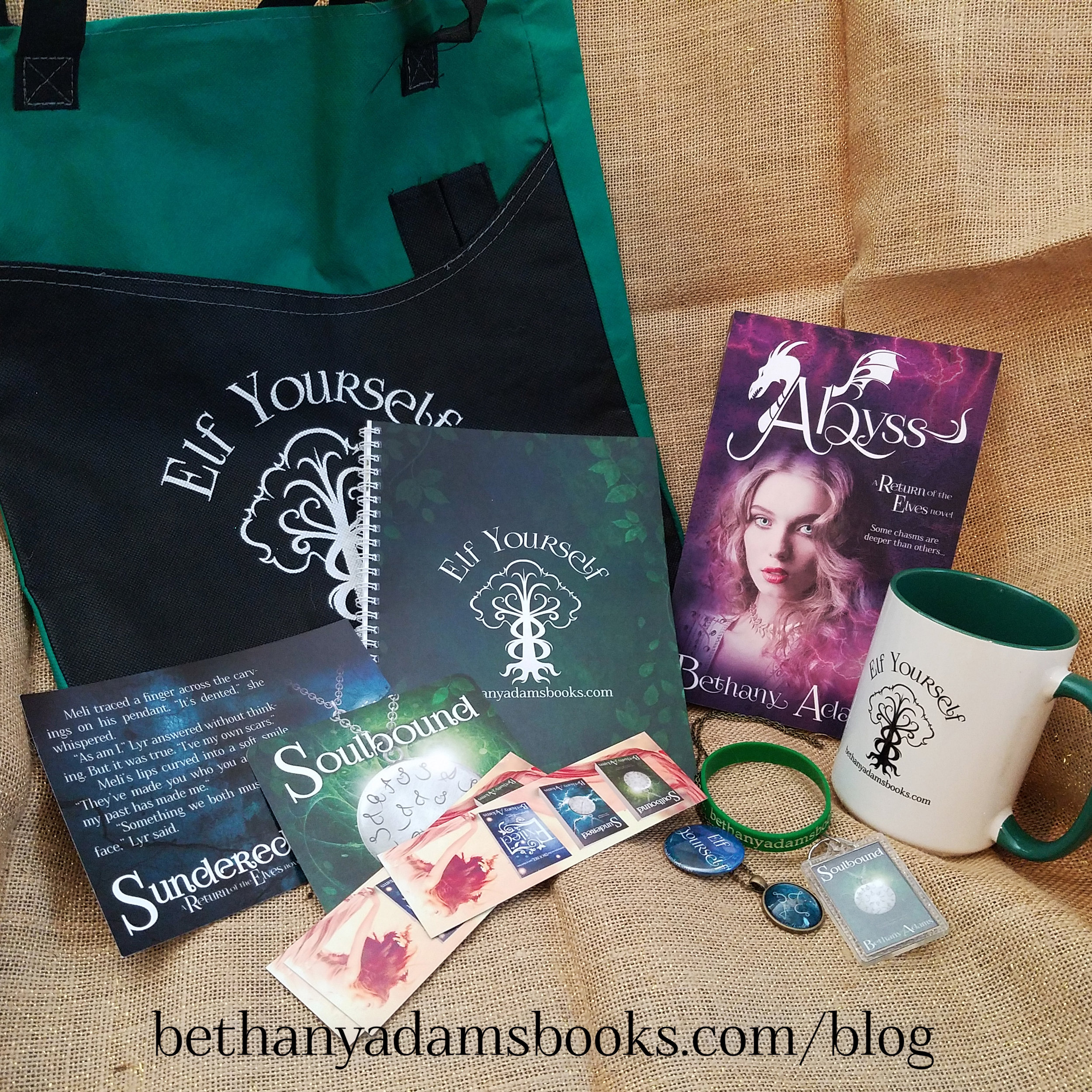 Swag Pack includes: Signed print proof of Abyss, Elf Yourself reusable bag, coffee cup, journal, handmade necklace, and assorted other swag.