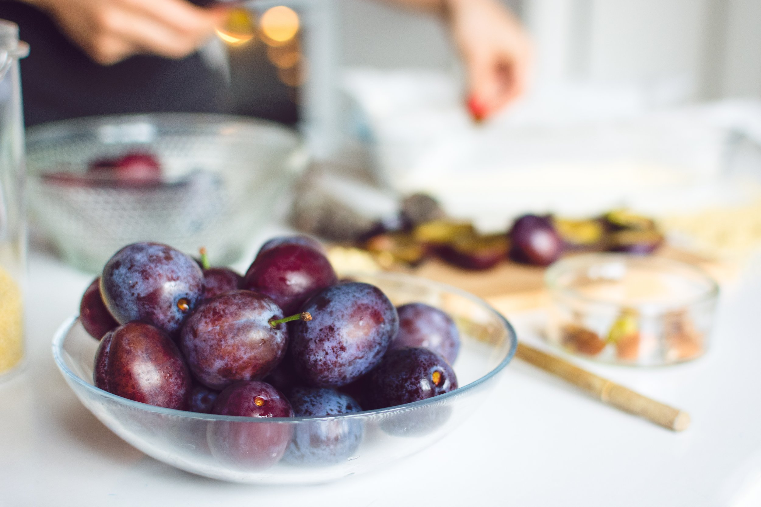 Grapes fill the foreground of a photo about cooking.