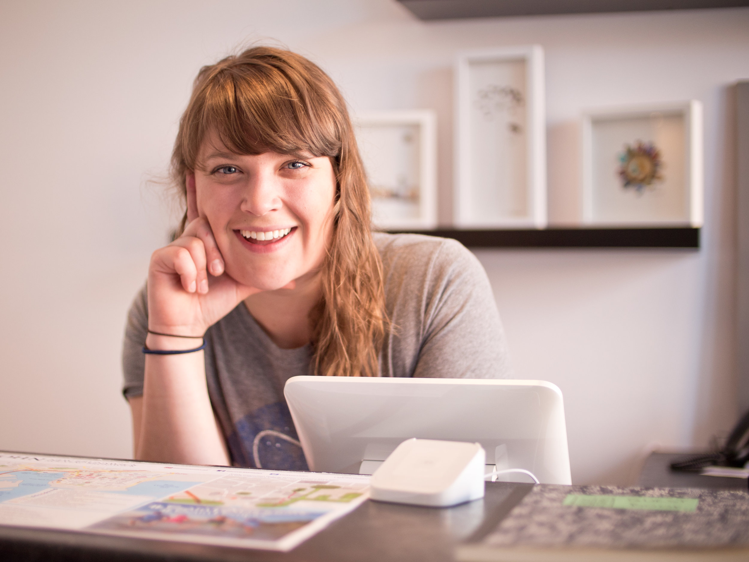 Ingrid Woodhouse, owner of BunkHaus Boutique Hostel, at the front desk.
