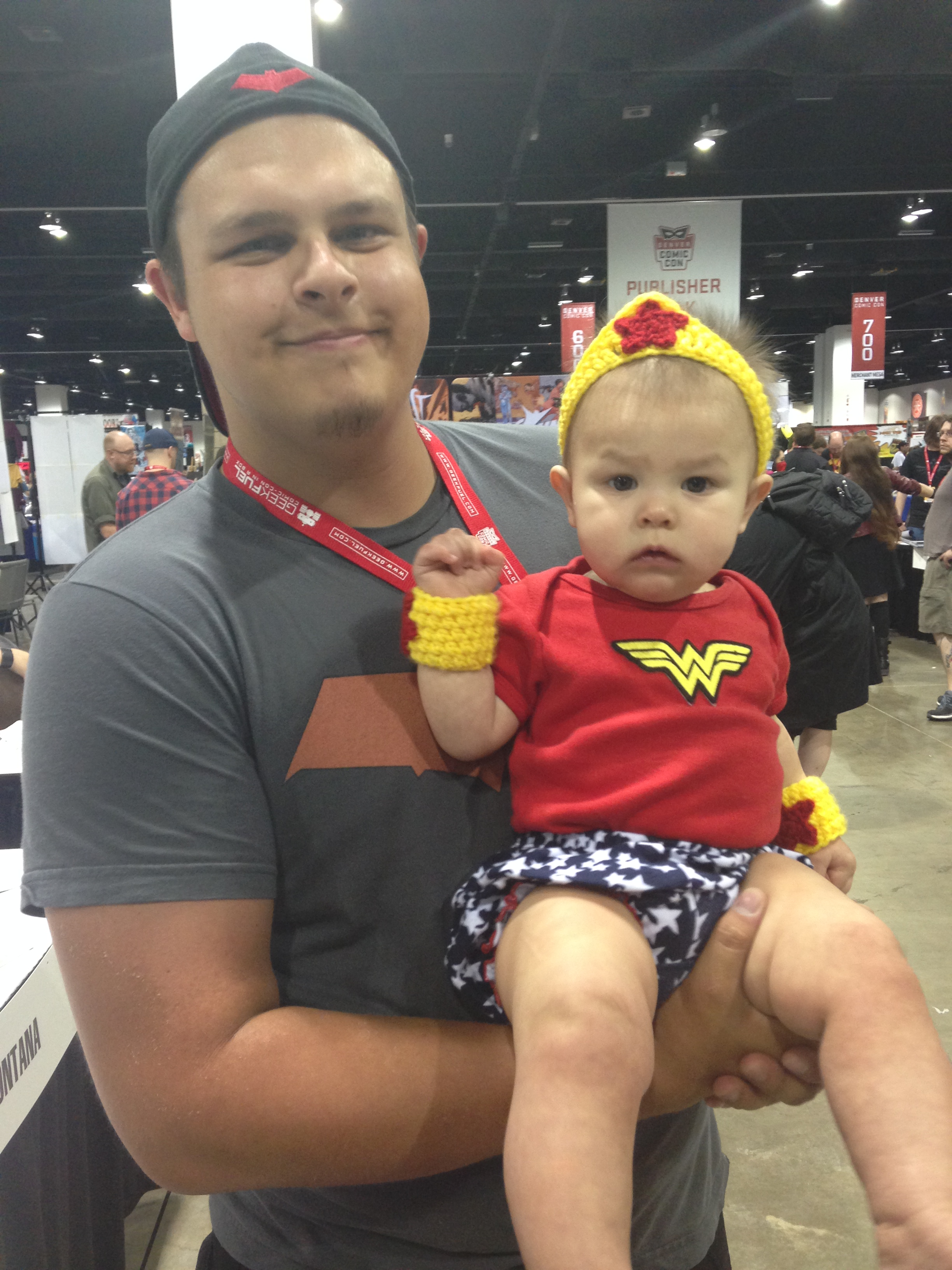 She ruled the con as tiny Wonder Woman! Here is Annabella with her daddy.