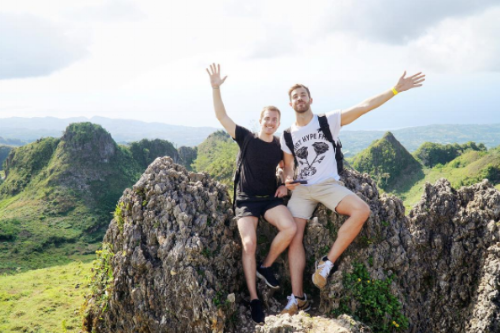 Miguel and Enrique atop Osmeña Peak after a breathtaking hike in Cebu, Philippines