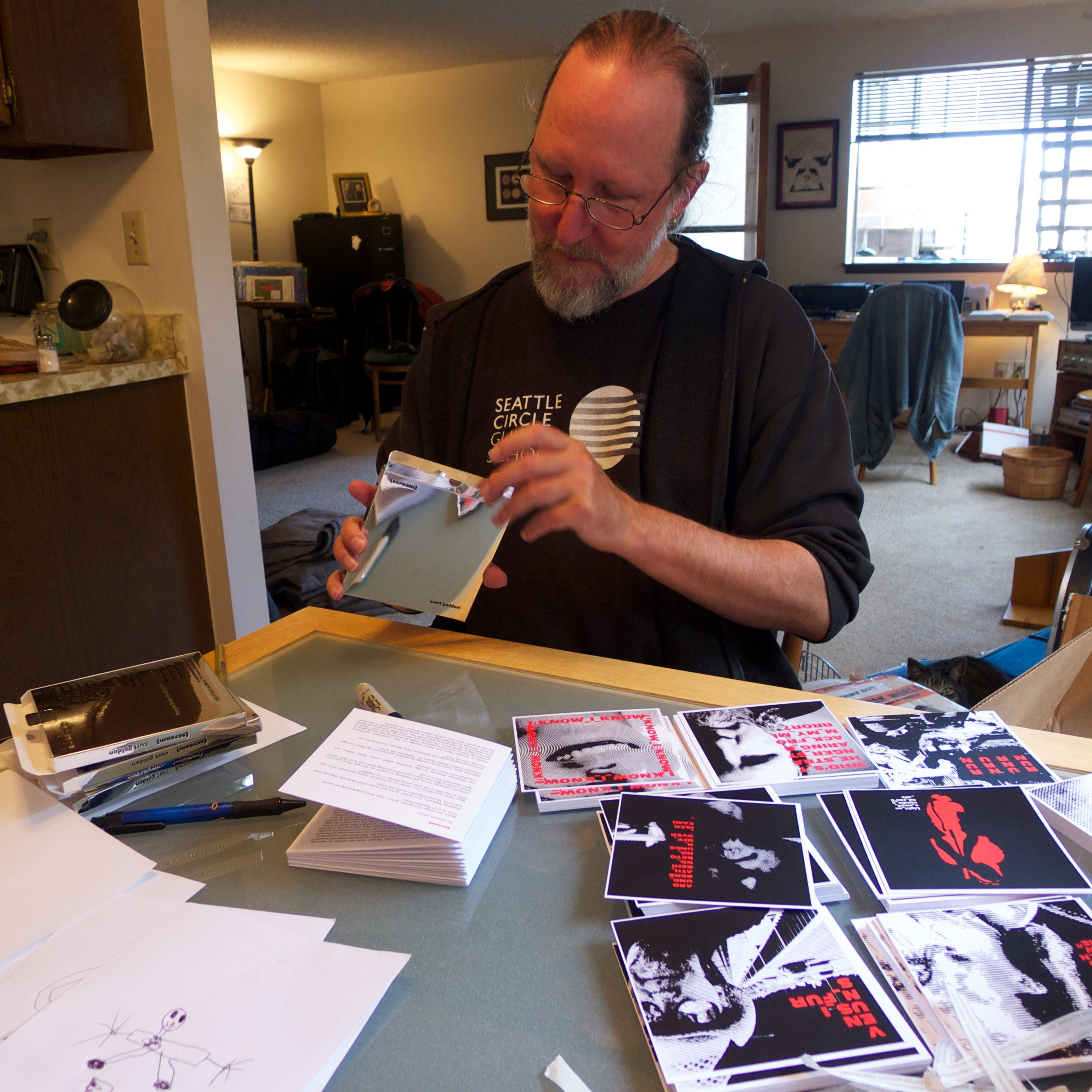 The artist assembling the limited addition packages. It's a glamorous life.