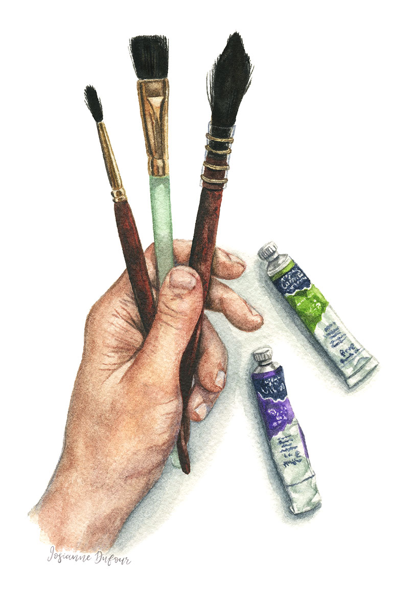 Watercolor paint tubes and brushes