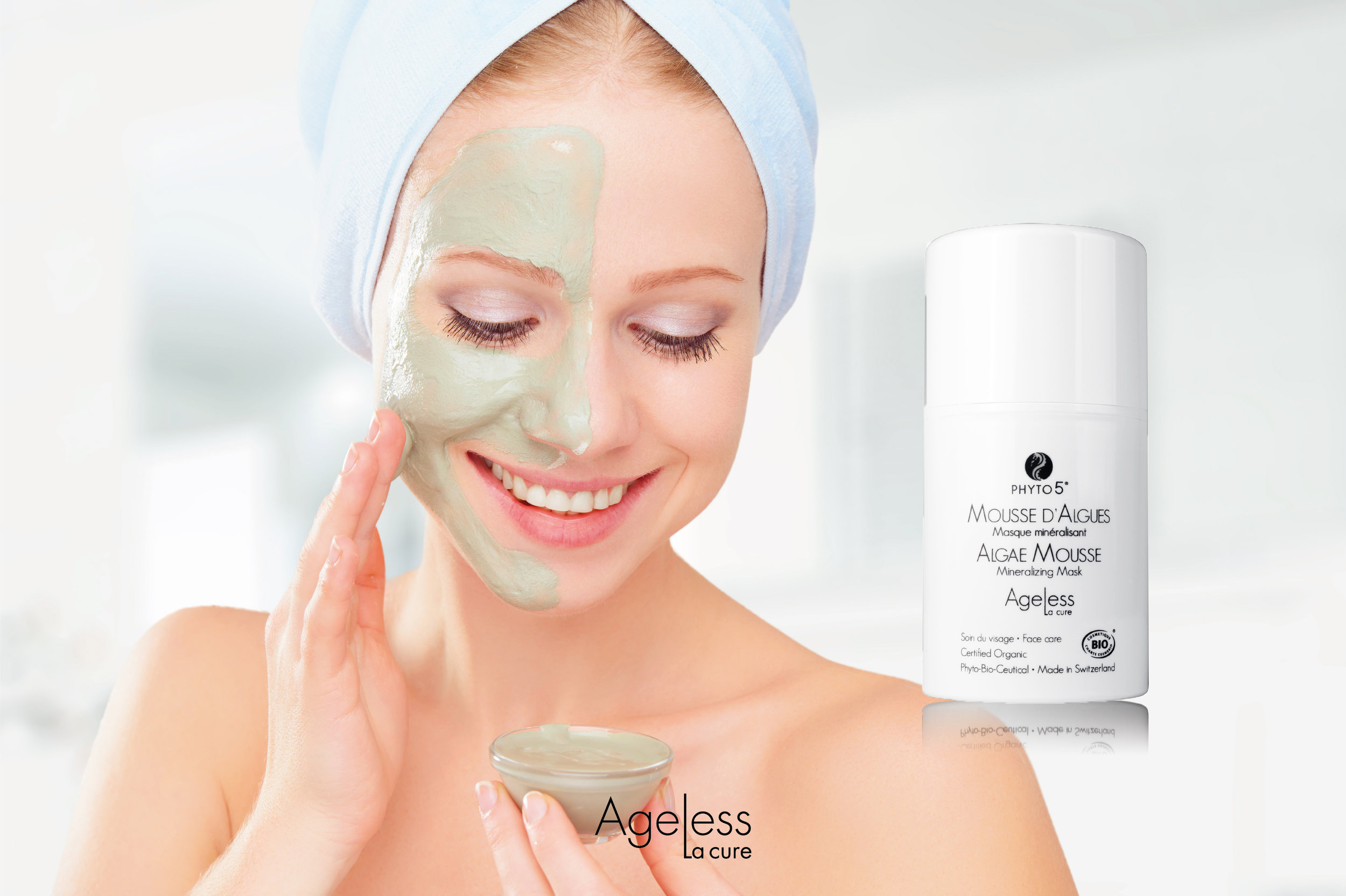 A woman enjoying Ageless La Cure Algae Mousse brushed onto one half of her face