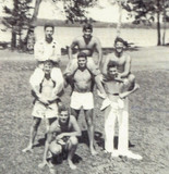 Mayer (top left) and friends at camp in 1947