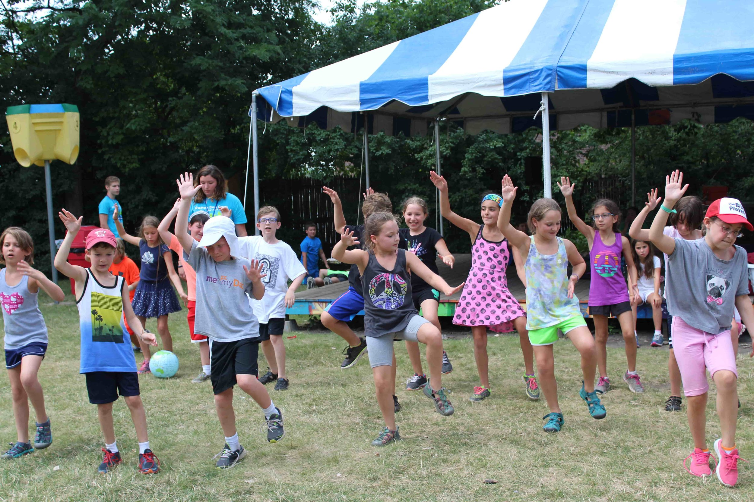 ריקוד / Israeli Dance - Dancing is one of the many fun ways our campers connect to Israel and express their Jewish identities. Every morning, line dances can be seen and heard as the buses unload. In addition to each individual group having time to learn age-appropriate dances, one of the highlights of the week is kikar (field) dancing at the end of hachanah l'Shabbat (Shabbat preparation). Imagine 200 campers and staff all dancing together at the same time!