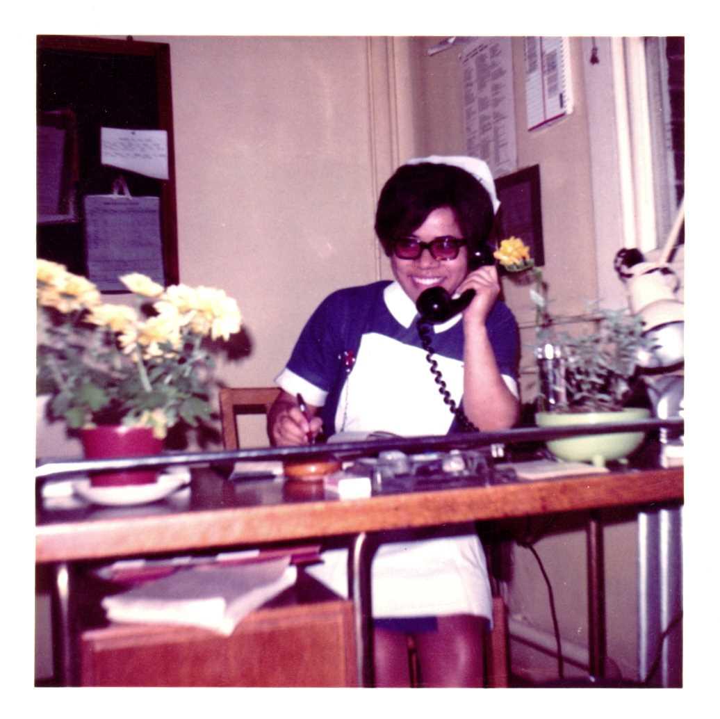 Nurse Elizabeth Anionwu wearing relaxed hair in 1969