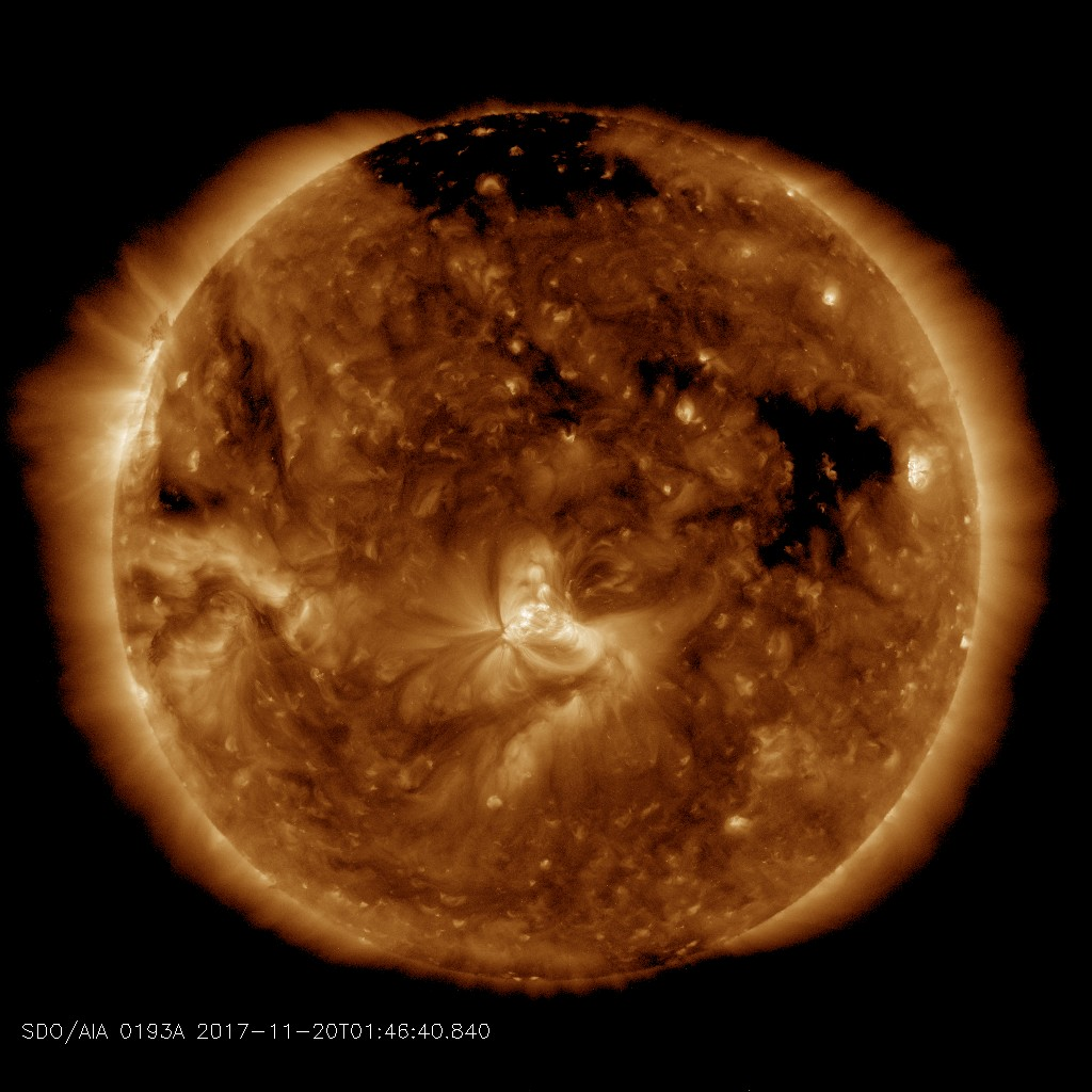 A stream of solar wind flowing from this southern coronal hole should reach Earth on Nov. 20-21. Credit: SDO/AIA