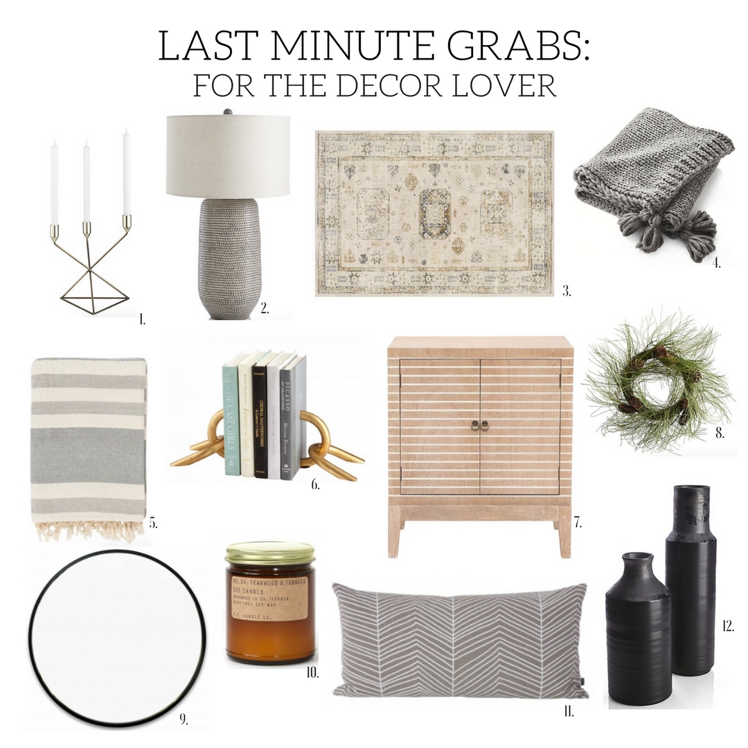 1. Brass Taper Candle Holder |   2. Cane Grey Table Lamp |   3. Jazzerus Beige Area Rug |   4. Dante Throw |   5. Vernon Throw |   6  . Slainie Bookends | 7. Pamela Accent Cabinet |   8. Long Needle Pine Wreath |   9. Holden Mirror - Black |   10. Pommes Frites Candle Co. |   11. Herringbone Pillow |   12. Nisa Vases |