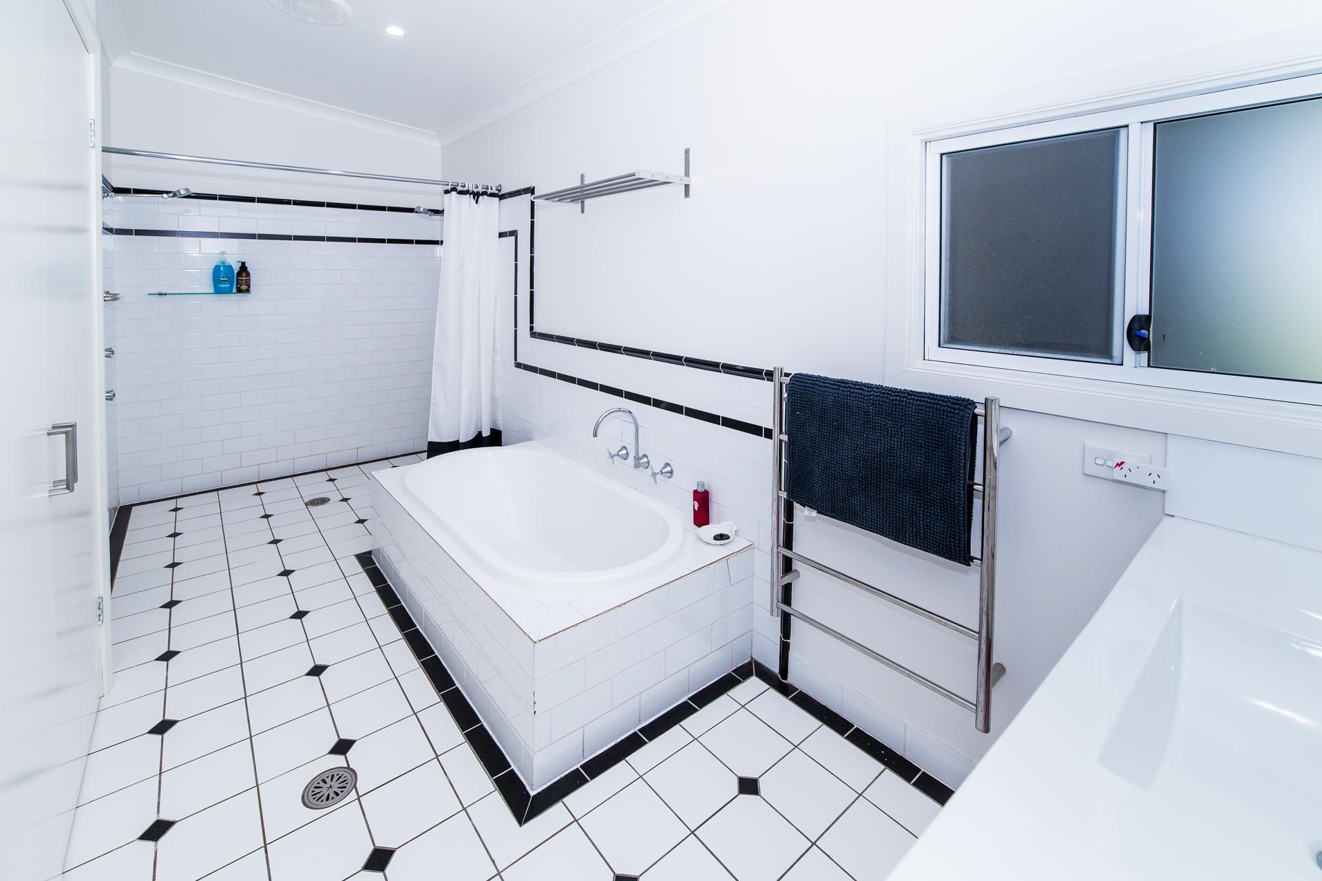 a spacious bathroom.. built in laundry..dual shower