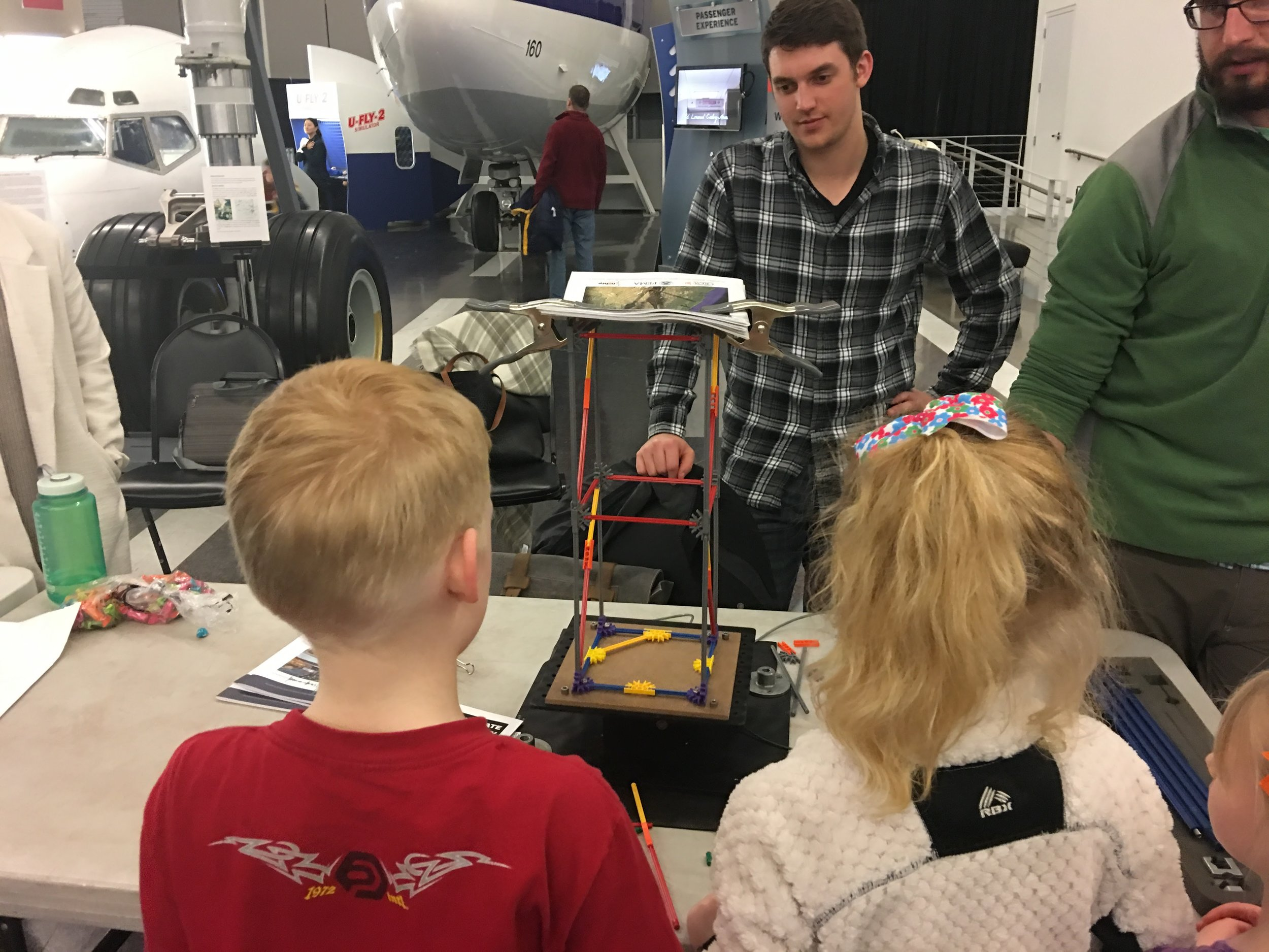 Students testing their structure on a shake table at last year's Family STEAM Night.
