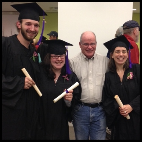 Instructor Charlie Kerrigan with 3 graduates