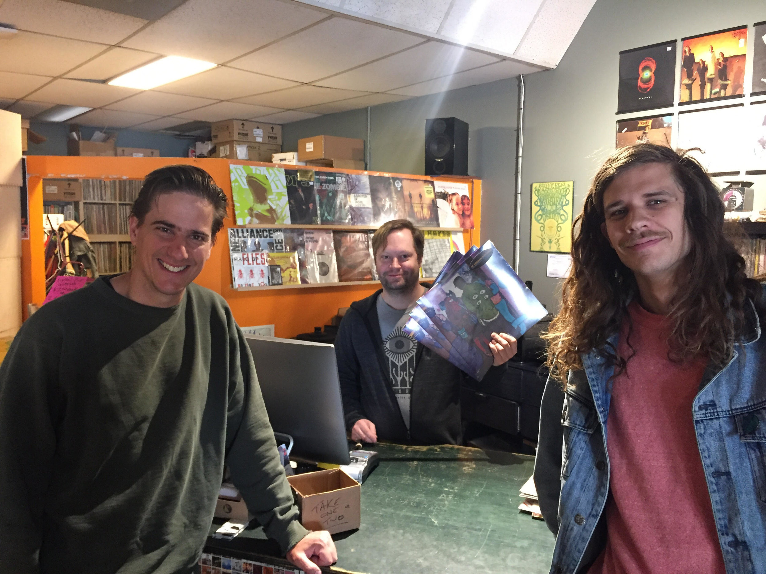 JP Lancaster (left) and Jared Doherty (right) with Kris Burwash (centre) from Listen Records in Edmonton, Alberta.