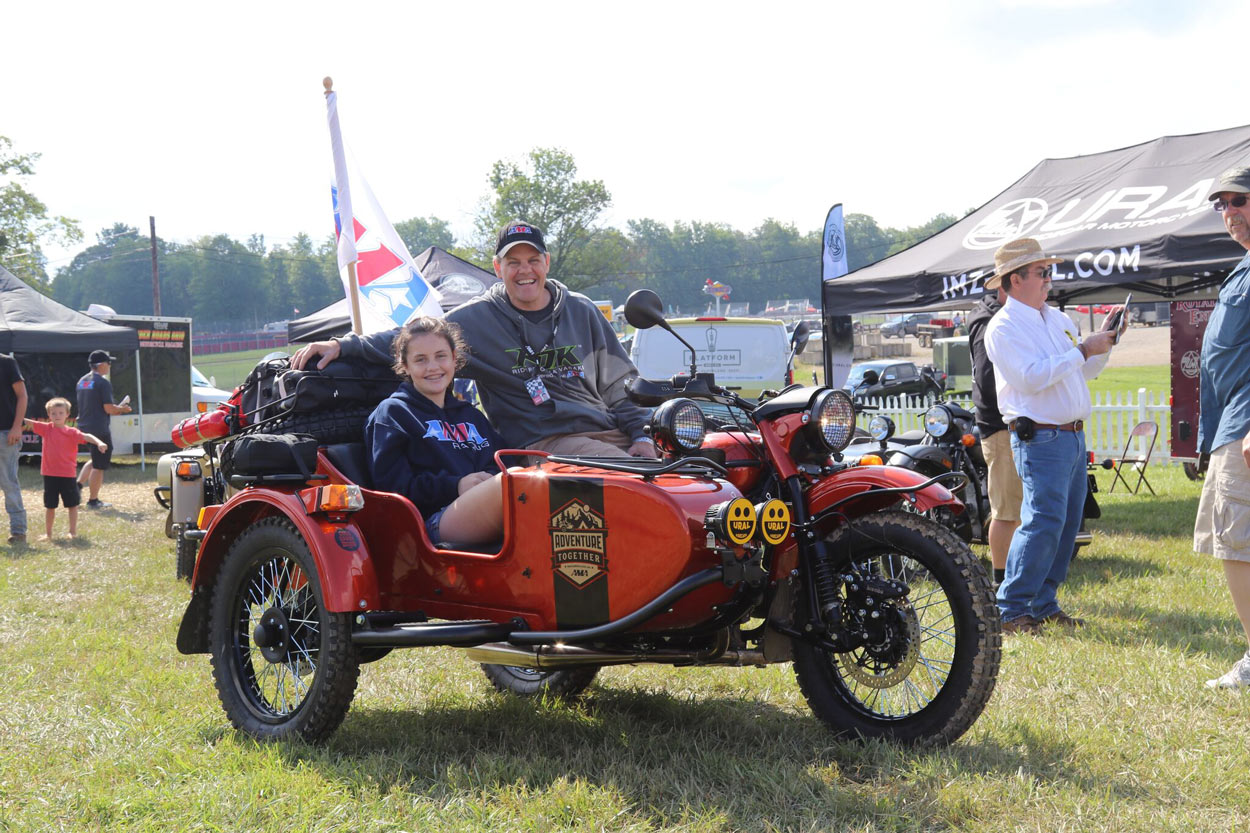 Flashback from last year's event:AMA President Rob Dingman and his daughter pose with the AMA Motorcycle Hall of Fame Museum Raffle Bike.