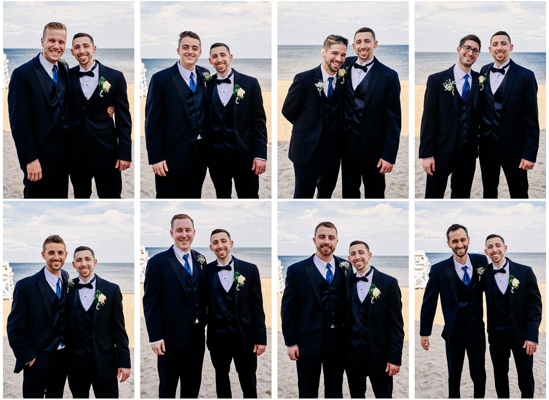 groom-with-groomsmen-on-beach-blue-and-black-suits.jpg