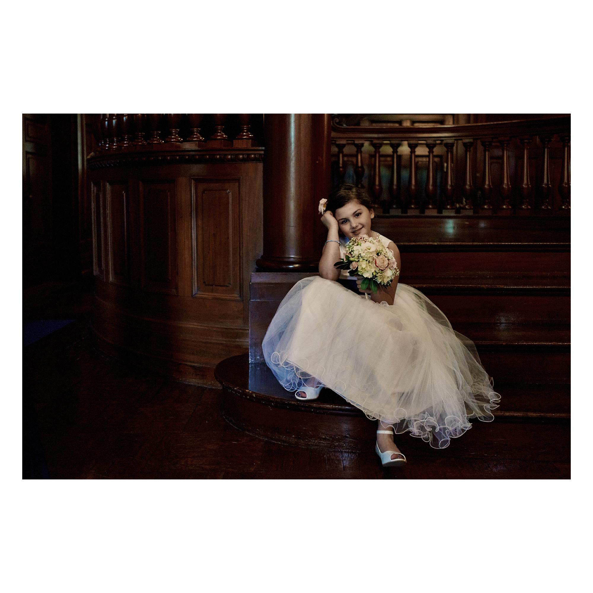 Flower girl on steps before wedding ceremony