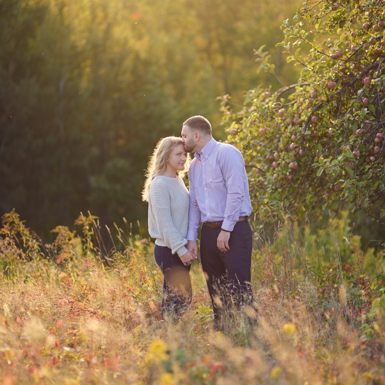 Anesa and Mahlik's Fall sunset engagement session in Meredith, NH on Lake Winnipesaukee