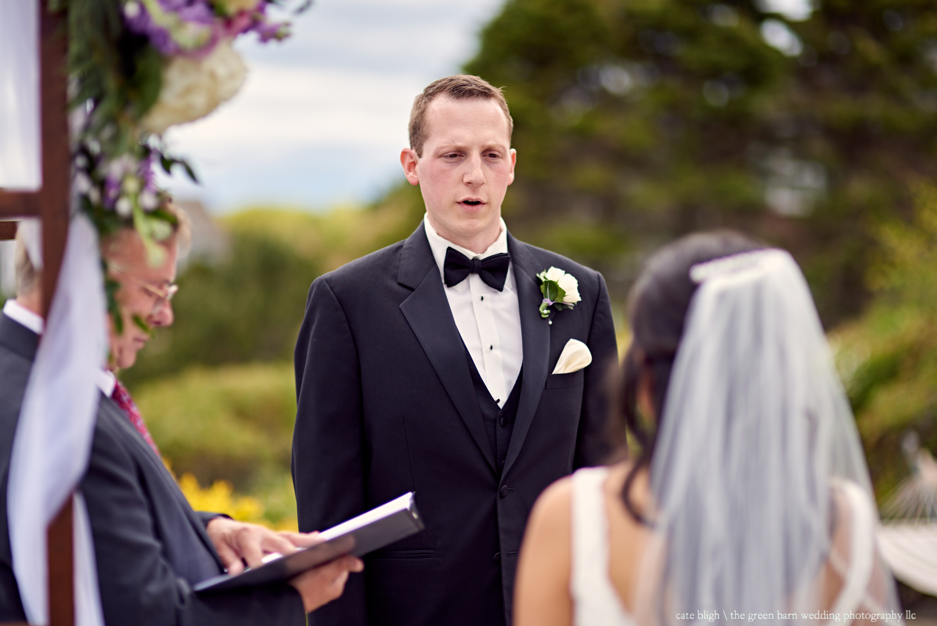 Wedding ceremony photos on the rocky coast of Maine