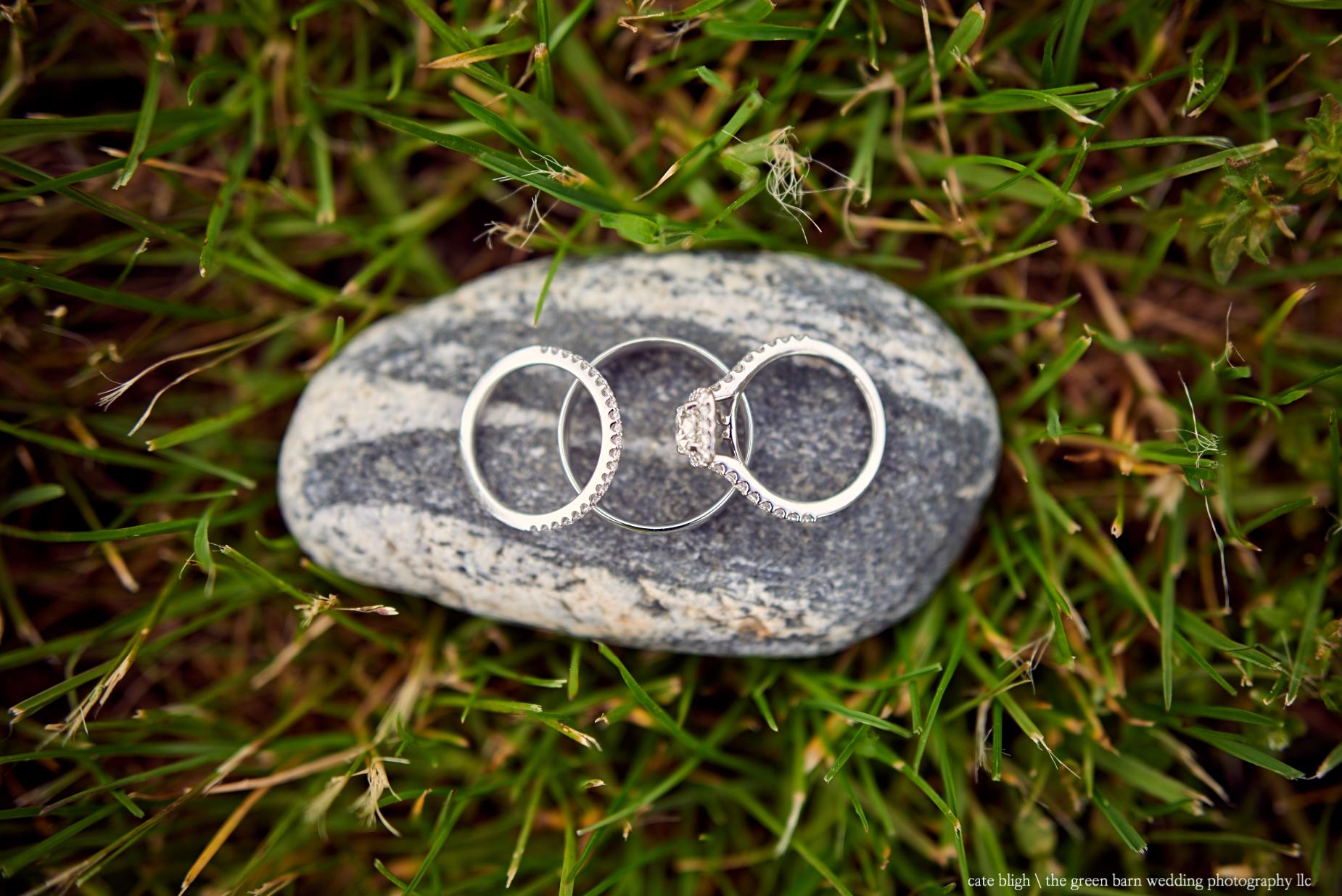 Wedding rings on smooth rock seacoast wedding inspiration