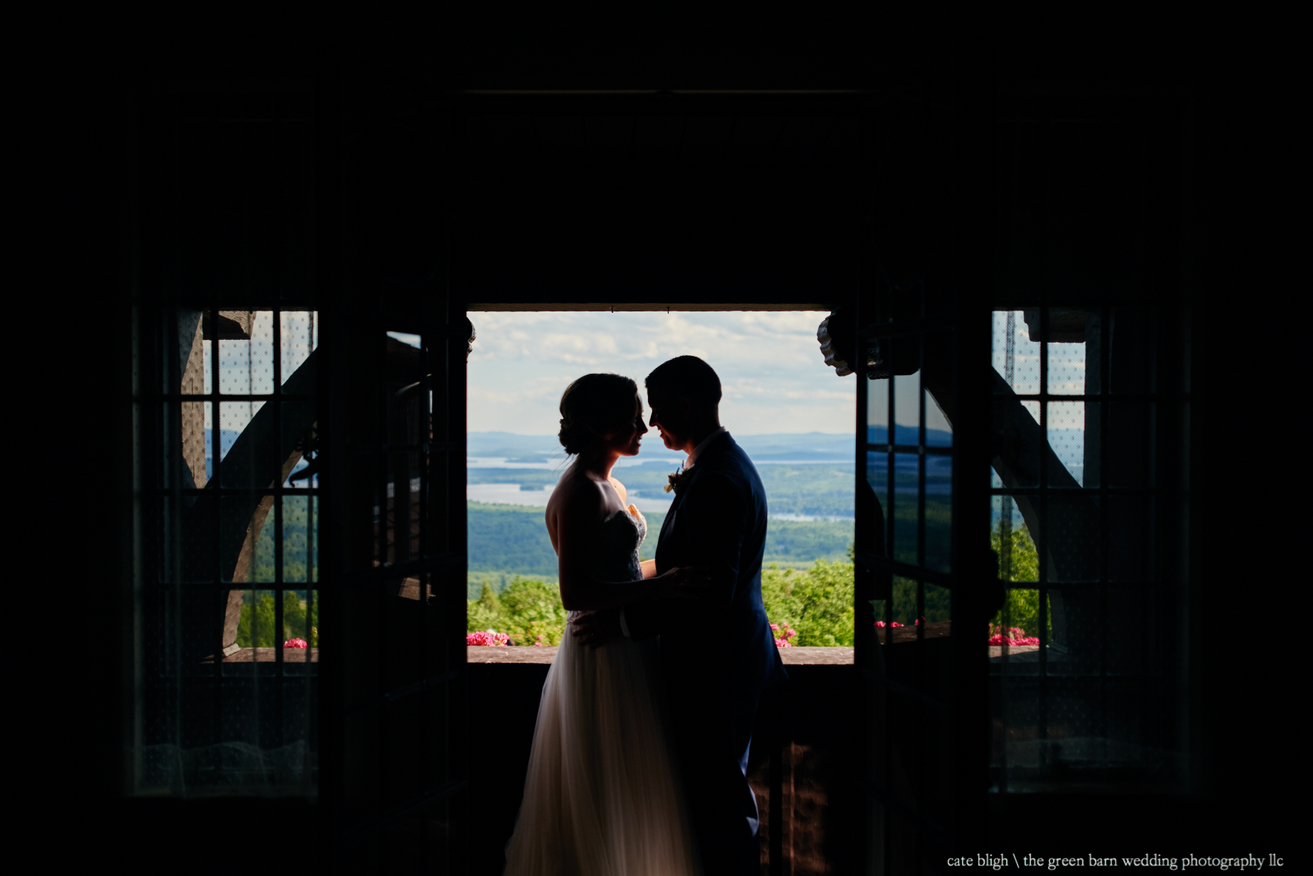 Bride and Groom in silhouette Castle in the Clouds NH